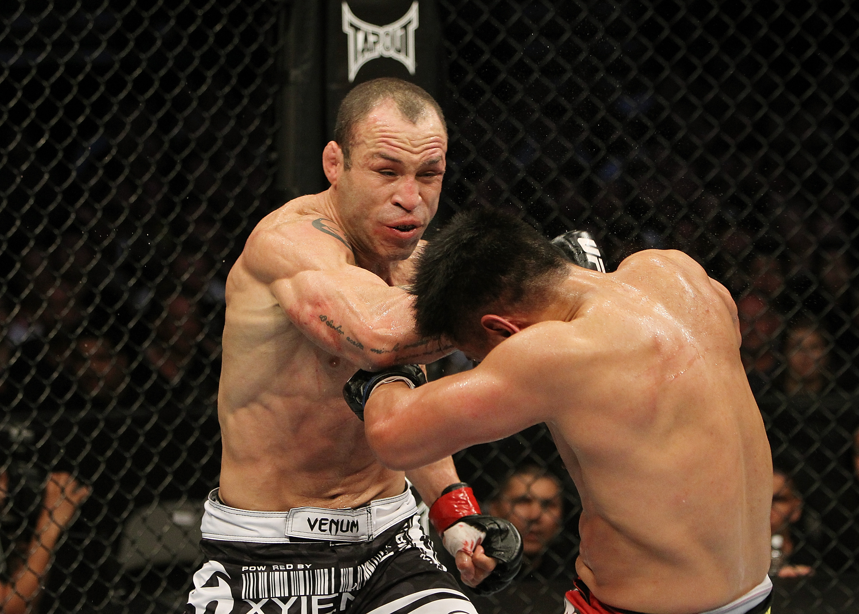 SAN JOSE, CA - NOVEMBER 19: (L-R) Wanderlei Silva punches Cung Le during an UFC Middleweight bout at the HP Pavillion on November 19, 2011 in San Jose, California.  (Photo by Josh Hedges/Zuffa LLC/Zuffa LLC via Getty Images)