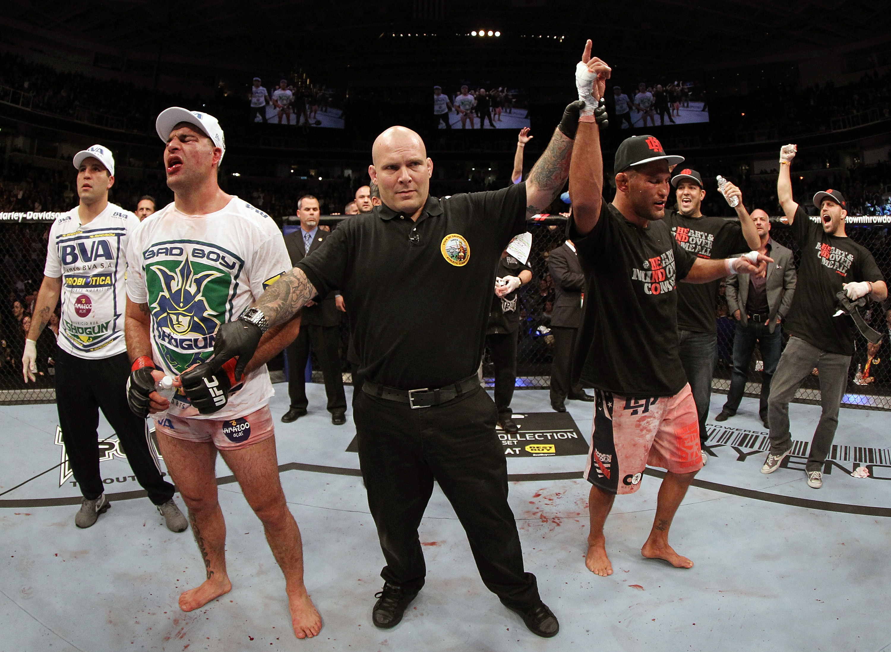 SAN JOSE, CA - NOVEMBER 19: (R-L) Dan Henderson celebrates defeating Mauricio Rua during a UFC Light Heavyweight bout at the HP Pavilion on November 19, 2011 in San Jose, California. (Photo by Josh Hedges/Zuffa LLC/Zuffa LLC via Getty Images)