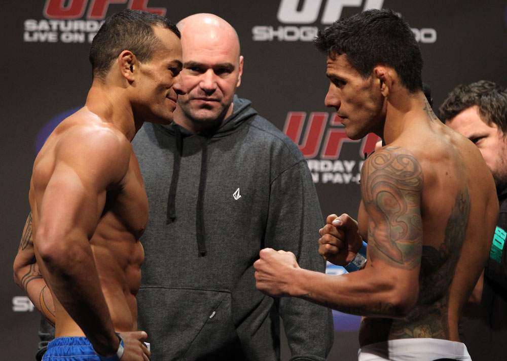 SAN JOSE, CA - NOVEMBER 18:  (L-R) Lightweight opponents Gleison Tibau and Rafael dos Anjos face off after weighing in during the UFC 139 Weigh In at the HP Pavilion on November 18, 2011 in San Jose, California.  (Photo by Josh Hedges/Zuffa LLC/Zuffa LLC via Getty Images)