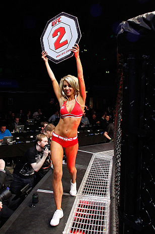 LONDON, ENGLAND - FEBRUARY 16:  UFC Octagon Girl Carly Baker introduces a round during the UFC on Fuel TV event on February 16, 2013 at Wembley Arena in London, England.  (Photo by Josh Hedges/Zuffa LLC/Zuffa LLC via Getty Images)