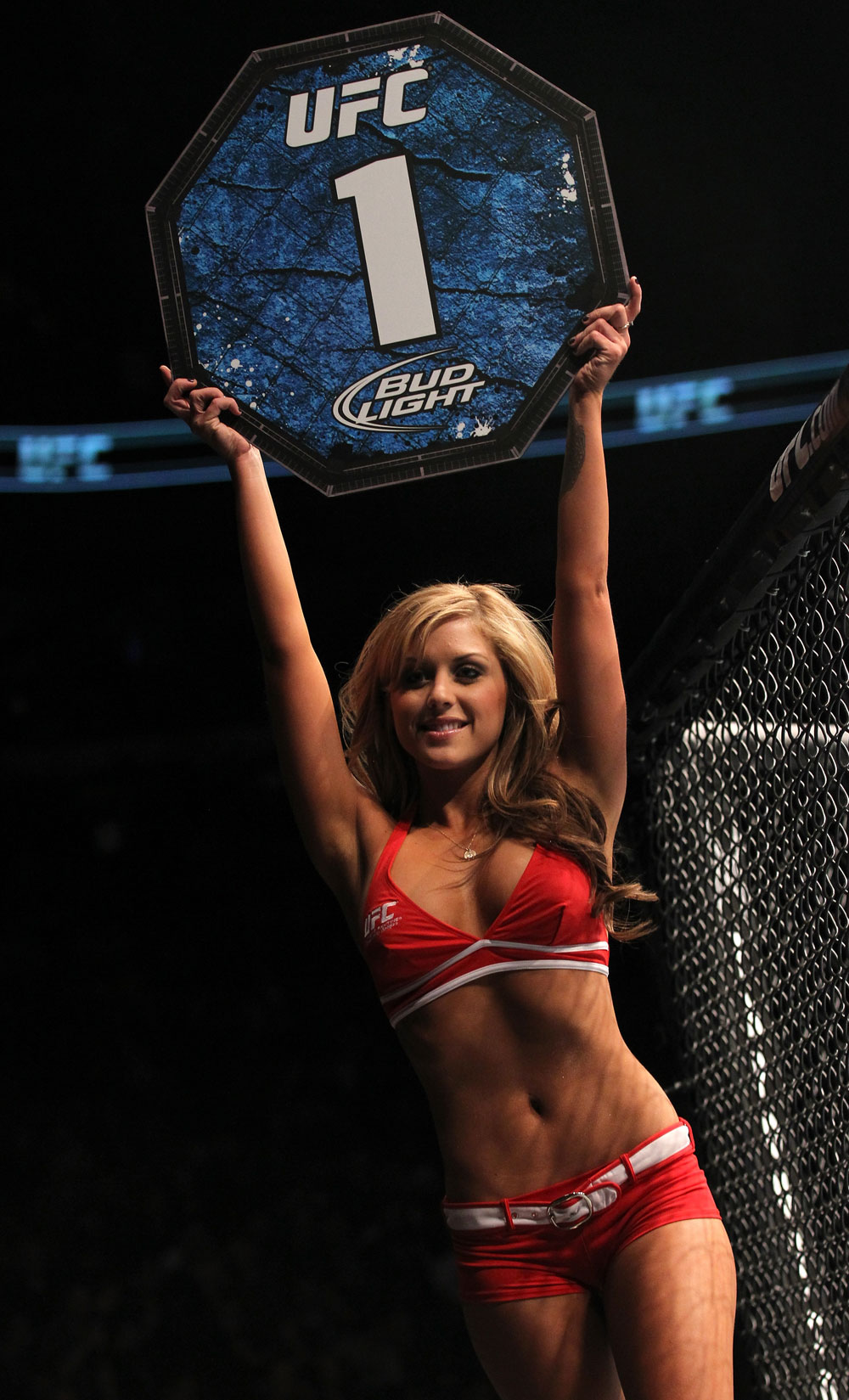 TORONTO, ON - DECEMBER 10:  UFC Octagon Girl Brittney Palmer introduces round one before the Hallman v Makdessi bout during the UFC 140 event at Air Canada Centre on December 10, 2011 in Toronto, Ontario, Canada.  (Photo by Nick Laham/Zuffa LLC/Zuffa LLC via Getty Images)