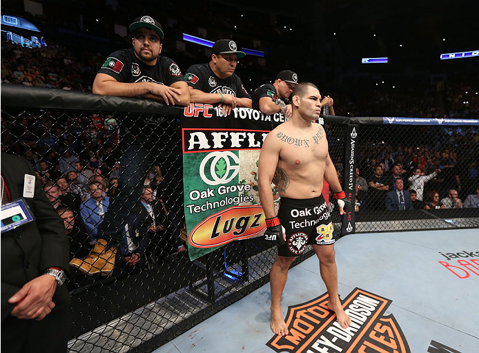 HOUSTON, TEXAS - OCTOBER 19:  Cain Velasquez stands in his corner of the Octagon before facing Junior Dos Santos (not pictured) in their UFC heavyweight championship bout at the Toyota Center on October 19, 2013 in Houston, Texas. (Photo by Nick Laham/Zuffa LLC/Zuffa LLC via Getty Images)