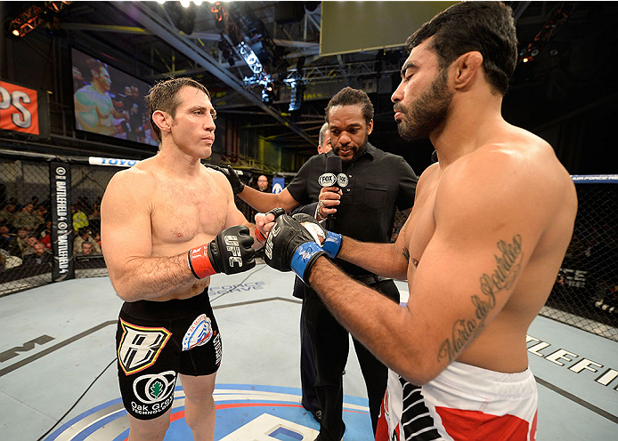 FORT CAMPBELL, KENTUCKY - NOVEMBER 6:  (L-R) Tim Kennedy and Rafael Natal touch gloves before their UFC middleweight bout on November 6, 2013 in Fort Campbell, Kentucky. (Photo by Jeff Bottari/Zuffa LLC/Zuffa LLC via Getty Images) *** Local Caption ***Tim Kennedy; Rafael Natal