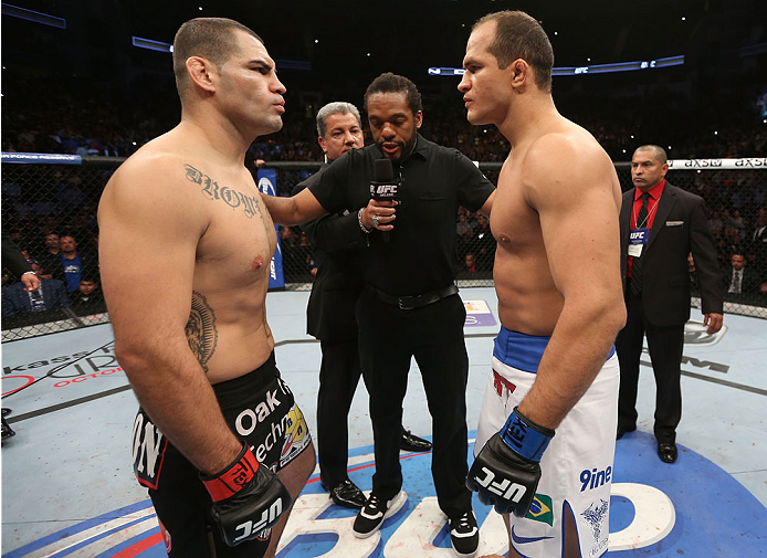 HOUSTON, TEXAS - OCTOBER 19:  (L-R) Cain Velasquez and Junior Dos Santos face off before their UFC heavyweight championship bout at the Toyota Center on October 19, 2013 in Houston, Texas. (Photo by Nick Laham/Zuffa LLC/Zuffa LLC via Getty Images)