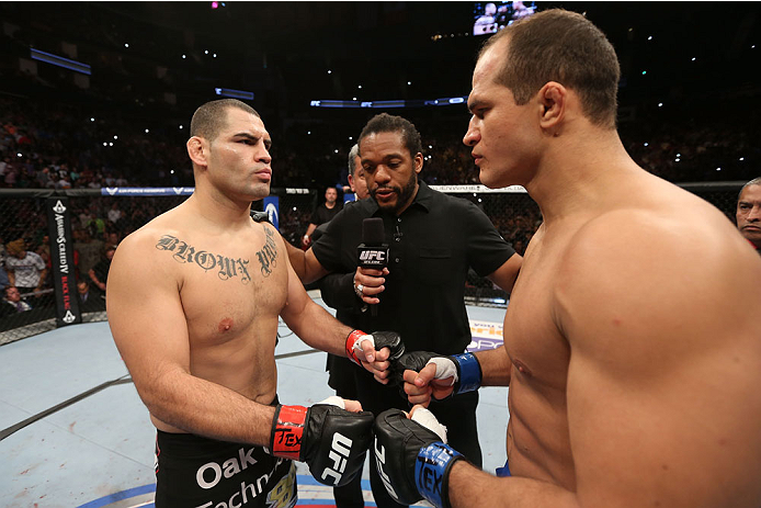 HOUSTON, TEXAS - OCTOBER 19:  (L-R) Cain Velasquez and Junior Dos Santos touch gloves before their UFC heavyweight championship bout at the Toyota Center on October 19, 2013 in Houston, Texas. (Photo by Nick Laham/Zuffa LLC/Zuffa LLC via Getty Images)