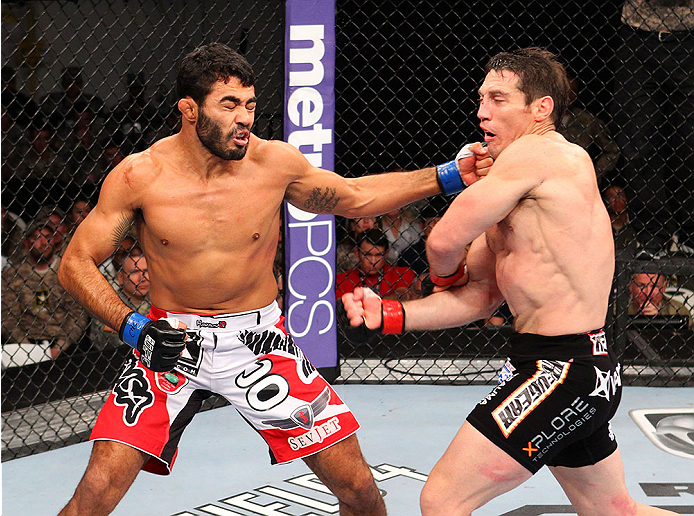 FORT CAMPBELL, KENTUCKY - NOVEMBER 6:  (L-R) Rafael Natal punches Tim Kennedy in their UFC middleweight bout on November 6, 2013 in Fort Campbell, Kentucky. (Photo by Ed Mulholland/Zuffa LLC/Zuffa LLC via Getty Images) *** Local Caption ***Tim Kennedy; Rafael Natal