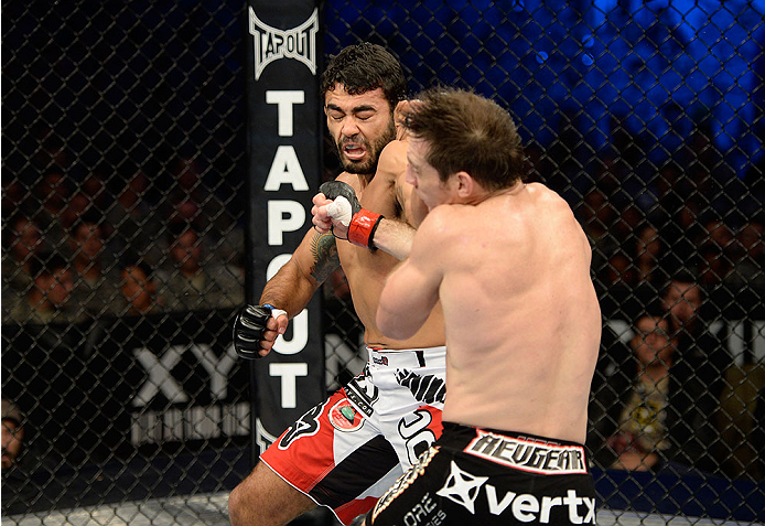 FORT CAMPBELL, KENTUCKY - NOVEMBER 6:  Rafael Natal (left) punches Tim Kennedy in their UFC middleweight bout on November 6, 2013 in Fort Campbell, Kentucky. (Photo by Jeff Bottari/Zuffa LLC/Zuffa LLC via Getty Images) *** Local Caption ***Tim Kennedy; Rafael Natal