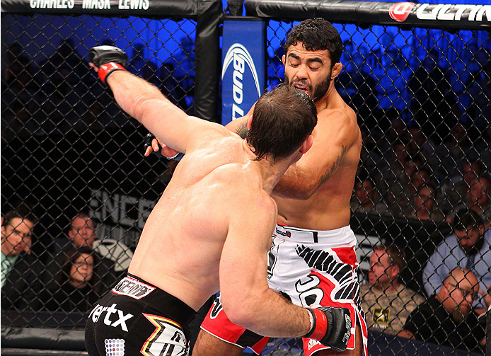 FORT CAMPBELL, KENTUCKY - NOVEMBER 6:  (L-R) Tim Kennedy punches Rafael Natal in their UFC middleweight bout on November 6, 2013 in Fort Campbell, Kentucky. (Photo by Ed Mulholland/Zuffa LLC/Zuffa LLC via Getty Images) *** Local Caption ***Tim Kennedy; Rafael Natal