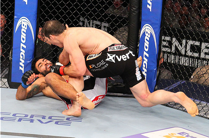FORT CAMPBELL, KENTUCKY - NOVEMBER 6:  (R-L) Tim Kennedy punches Rafael Natal in their UFC middleweight bout on November 6, 2013 in Fort Campbell, Kentucky. (Photo by Ed Mulholland/Zuffa LLC/Zuffa LLC via Getty Images) *** Local Caption ***Tim Kennedy; Rafael Natal