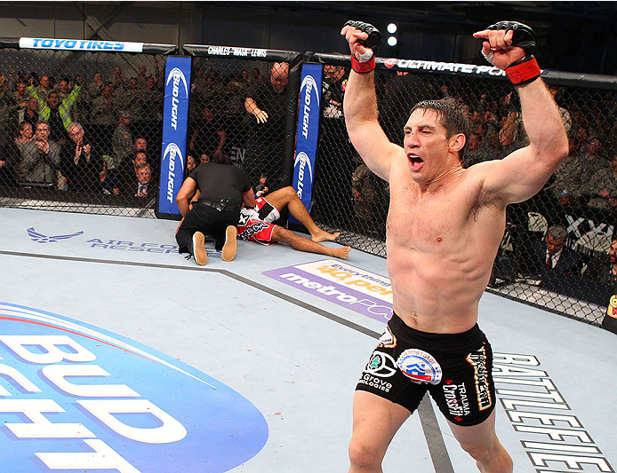 FORT CAMPBELL, KENTUCKY - NOVEMBER 6:  Tim Kennedy (right) reacts to his knockout victory over Rafael Natal in their UFC middleweight bout on November 6, 2013 in Fort Campbell, Kentucky. (Photo by Ed Mulholland/Zuffa LLC/Zuffa LLC via Getty Images) *** Local Caption ***Tim Kennedy