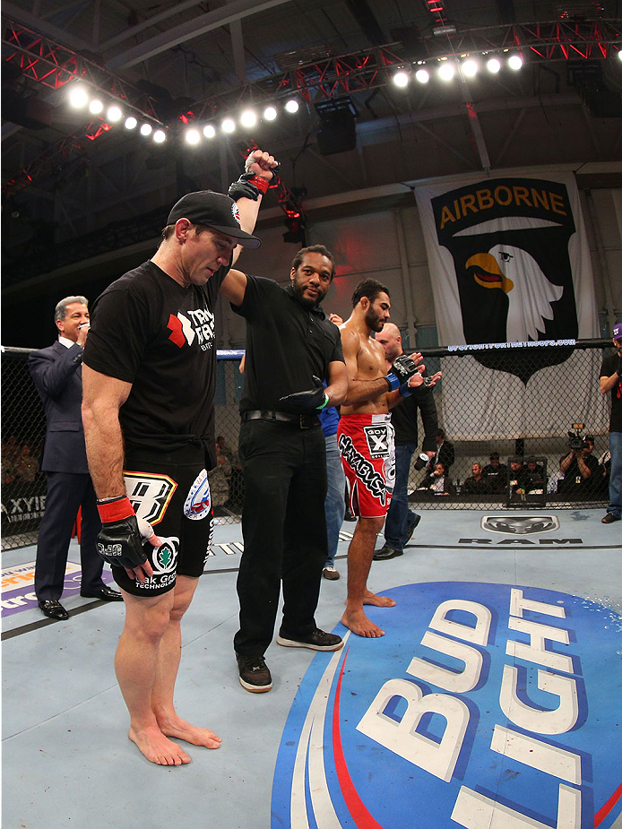 FORT CAMPBELL, KENTUCKY - NOVEMBER 6:  Tim Kennedy (left) is declared the winner over Rafael Natal (red shorts) in their UFC middleweight bout on November 6, 2013 in Fort Campbell, Kentucky. (Photo by Ed Mulholland/Zuffa LLC/Zuffa LLC via Getty Images) *** Local Caption ***Tim Kennedy; Rafael Natal