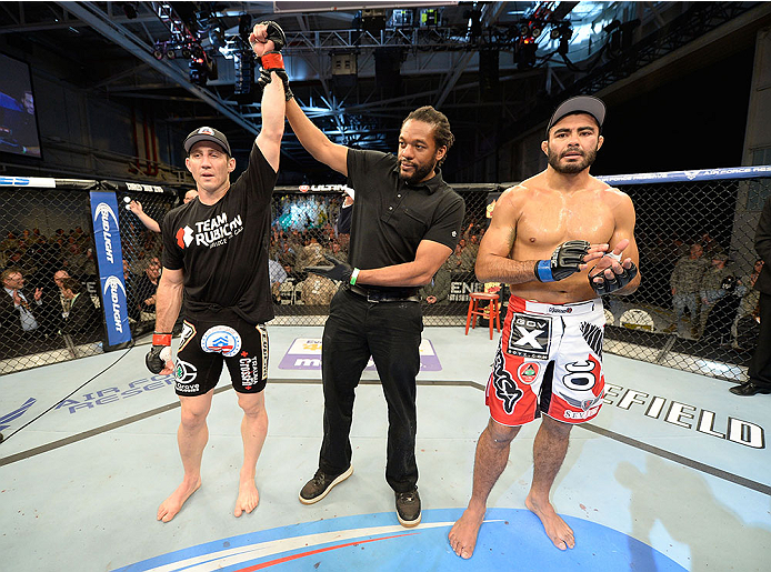 FORT CAMPBELL, KENTUCKY - NOVEMBER 6:  Tim Kennedy (left) is declared the winner over Rafael Natal (right) in their UFC middleweight bout on November 6, 2013 in Fort Campbell, Kentucky. (Photo by Jeff Bottari/Zuffa LLC/Zuffa LLC via Getty Images) *** Local Caption ***Tim Kennedy; Rafael Natal