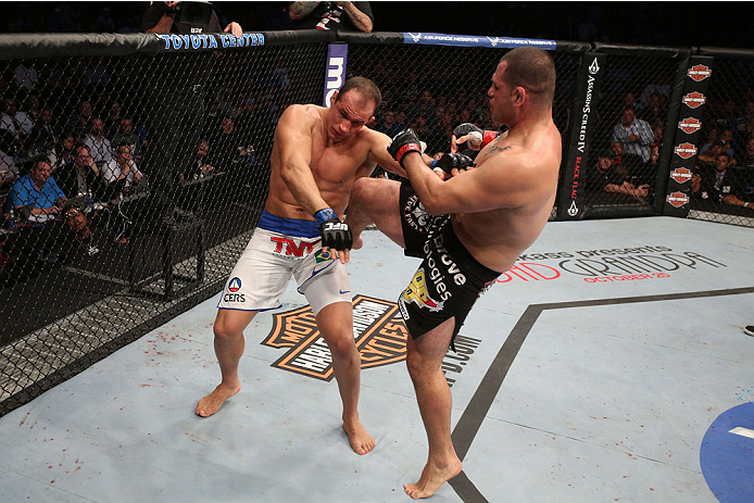 HOUSTON, TEXAS - OCTOBER 19:  (R-L) Cain Velasquez kicks Junior Dos Santos in their UFC heavyweight championship bout at the Toyota Center on October 19, 2013 in Houston, Texas. (Photo by Nick Laham/Zuffa LLC/Zuffa LLC via Getty Images)