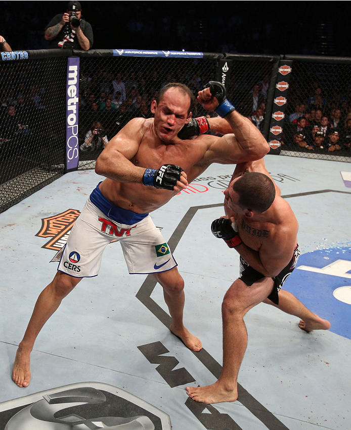 HOUSTON, TEXAS - OCTOBER 19:  (R-L) Cain Velasquez punches Junior Dos Santos in their UFC heavyweight championship bout at the Toyota Center on October 19, 2013 in Houston, Texas. (Photo by Nick Laham/Zuffa LLC/Zuffa LLC via Getty Images)