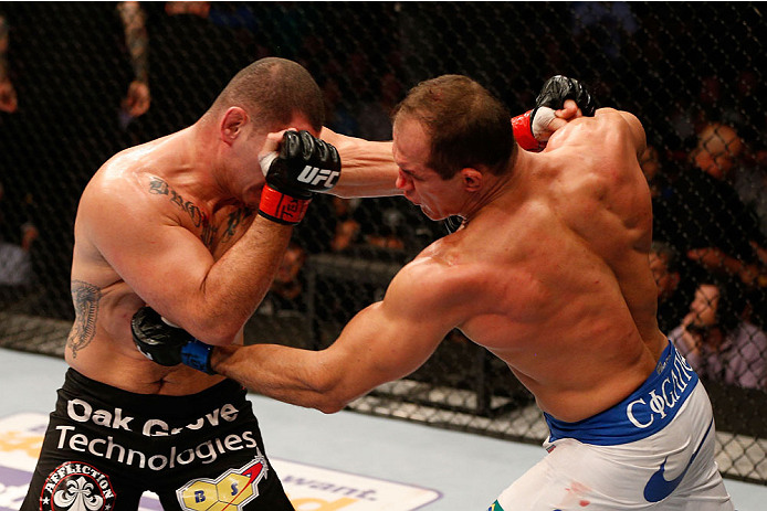 HOUSTON, TEXAS - OCTOBER 19:  (R-L) Junior Dos Santos punches Cain Velasquez in their UFC heavyweight championship bout at the Toyota Center on October 19, 2013 in Houston, Texas. (Photo by Josh Hedges/Zuffa LLC/Zuffa LLC via Getty Images)
