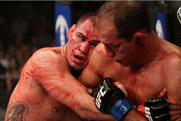 HOUSTON, TEXAS - OCTOBER 19:  (L-R) Cain Velasquez leans on Junior Dos Santos in their UFC heavyweight championship bout at the Toyota Center on October 19, 2013 in Houston, Texas. (Photo by Nick Laham/Zuffa LLC/Zuffa LLC via Getty Images)
