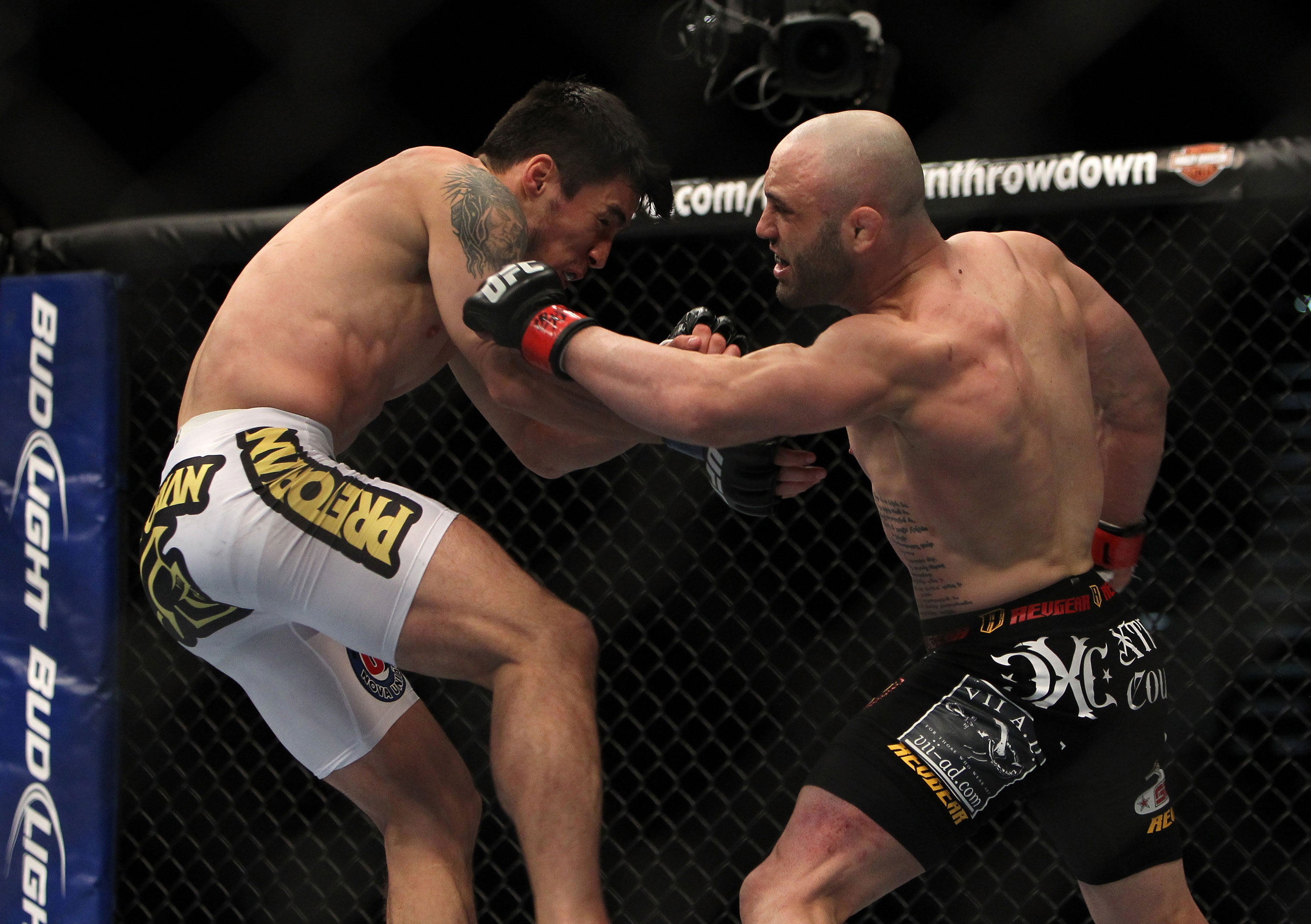 LAS VEGAS, NV - DECEMBER 30:  Manny Gamburyan (right) punches Diego Nunes (left) during the UFC 141 event at the MGM Grand Garden Arena on December 30, 2011 in Las Vegas, Nevada.  (Photo by Josh Hedges/Zuffa LLC/Zuffa LLC via Getty Images) *** Local Caption *** Manny Gamburyan; Diego Nunes