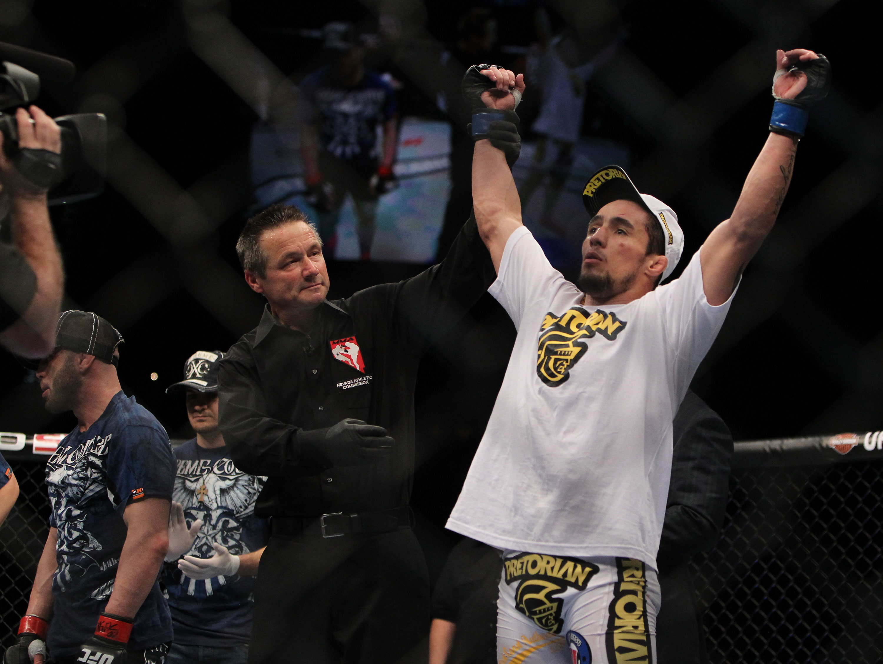 LAS VEGAS, NV - DECEMBER 30:  Diego Nunes is declared the winner in his bout against Manny Gamburyan during the UFC 141 event at the MGM Grand Garden Arena on December 30, 2011 in Las Vegas, Nevada.  (Photo by Josh Hedges/Zuffa LLC/Zuffa LLC via Getty Images) *** Local Caption *** Diego Nunes