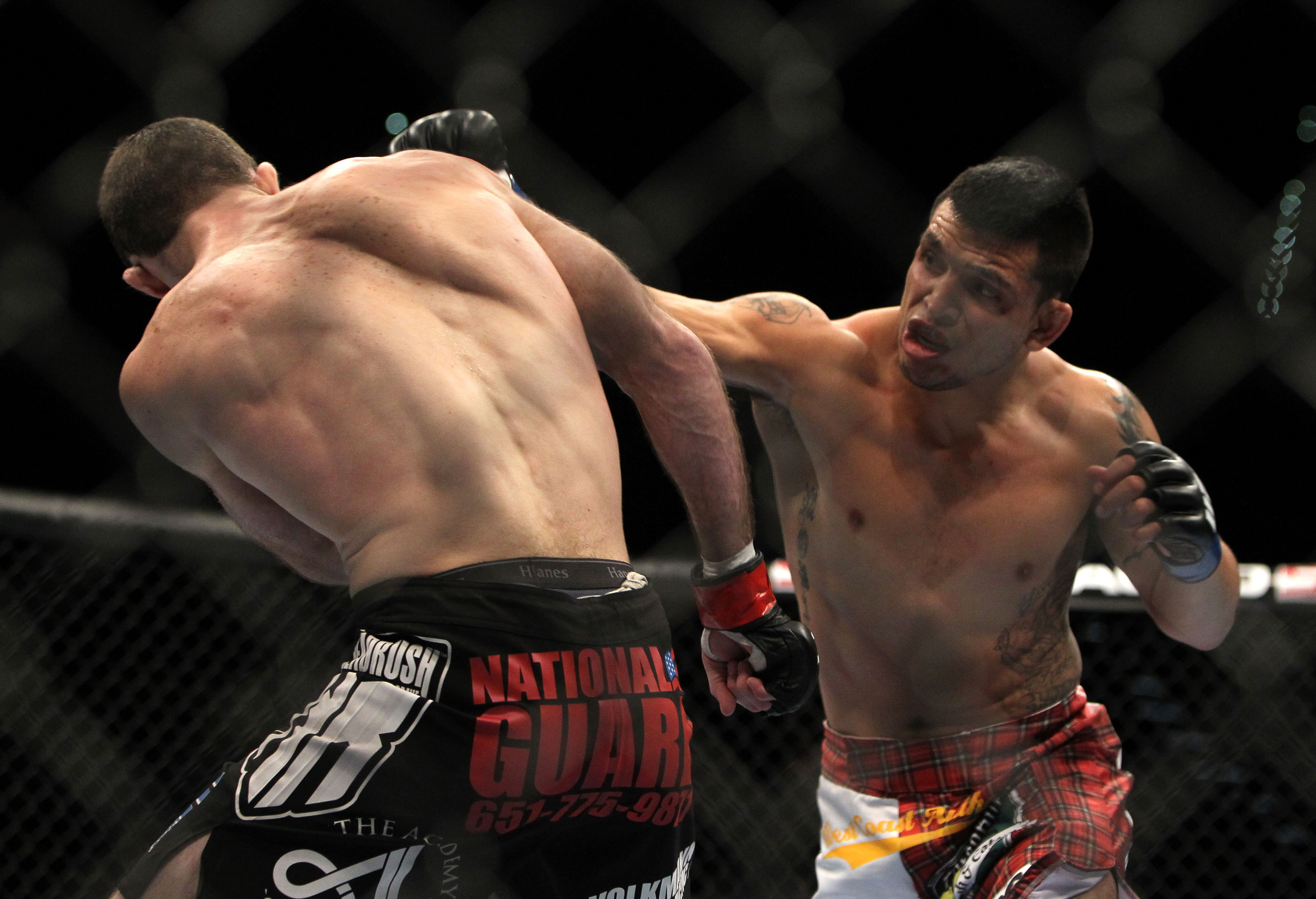 LAS VEGAS, NV - DECEMBER 30:  Efrain Escudero (right) punches Jacob Volkmann during the UFC 141 event at the MGM Grand Garden Arena on December 30, 2011 in Las Vegas, Nevada.  (Photo by Josh Hedges/Zuffa LLC/Zuffa LLC via Getty Images) *** Local Caption *** Efrain Escudero; Jacob Volkmann