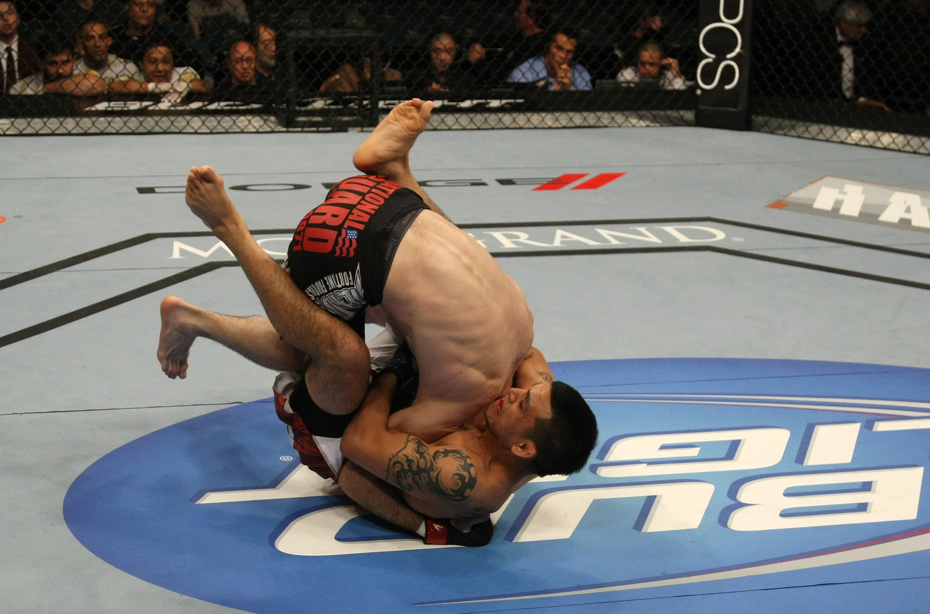 LAS VEGAS, NV - DECEMBER 30:  Efrain Escudero (bottom) attempts to submit Jacob Volkmann during the UFC 141 event at the MGM Grand Garden Arena on December 30, 2011 in Las Vegas, Nevada.  (Photo by Donald Miralle/Zuffa LLC/Zuffa LLC via Getty Images) *** Local Caption *** Efrain Escudero; Jacob Volkmann