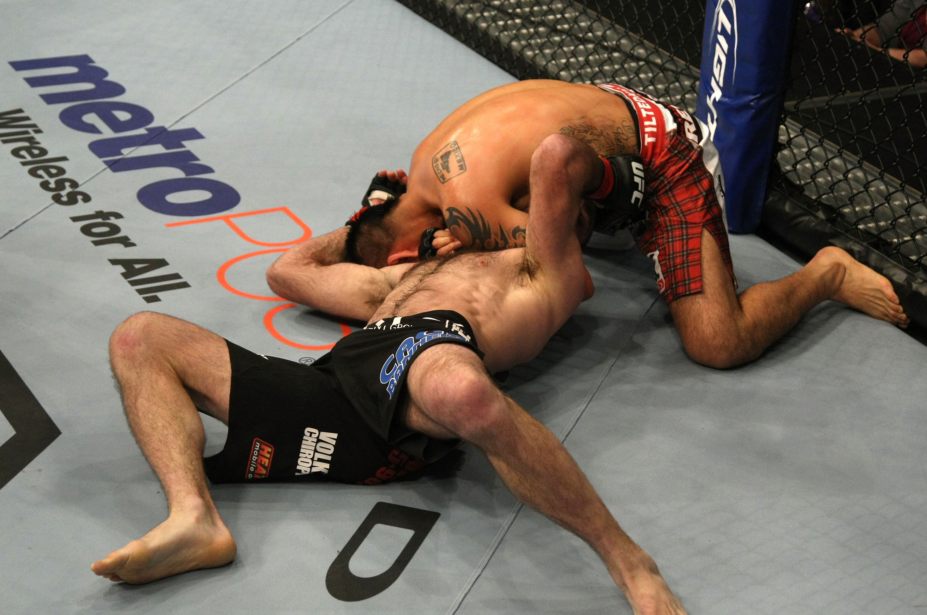 LAS VEGAS, NV - DECEMBER 30:  Efrain Escudero (top) attempts to choke out Jacob Volkmann during the UFC 141 event at the MGM Grand Garden Arena on December 30, 2011 in Las Vegas, Nevada.  (Photo by Donald Miralle/Zuffa LLC/Zuffa LLC via Getty Images) *** Local Caption *** Efrain Escudero; Jacob Volkmann
