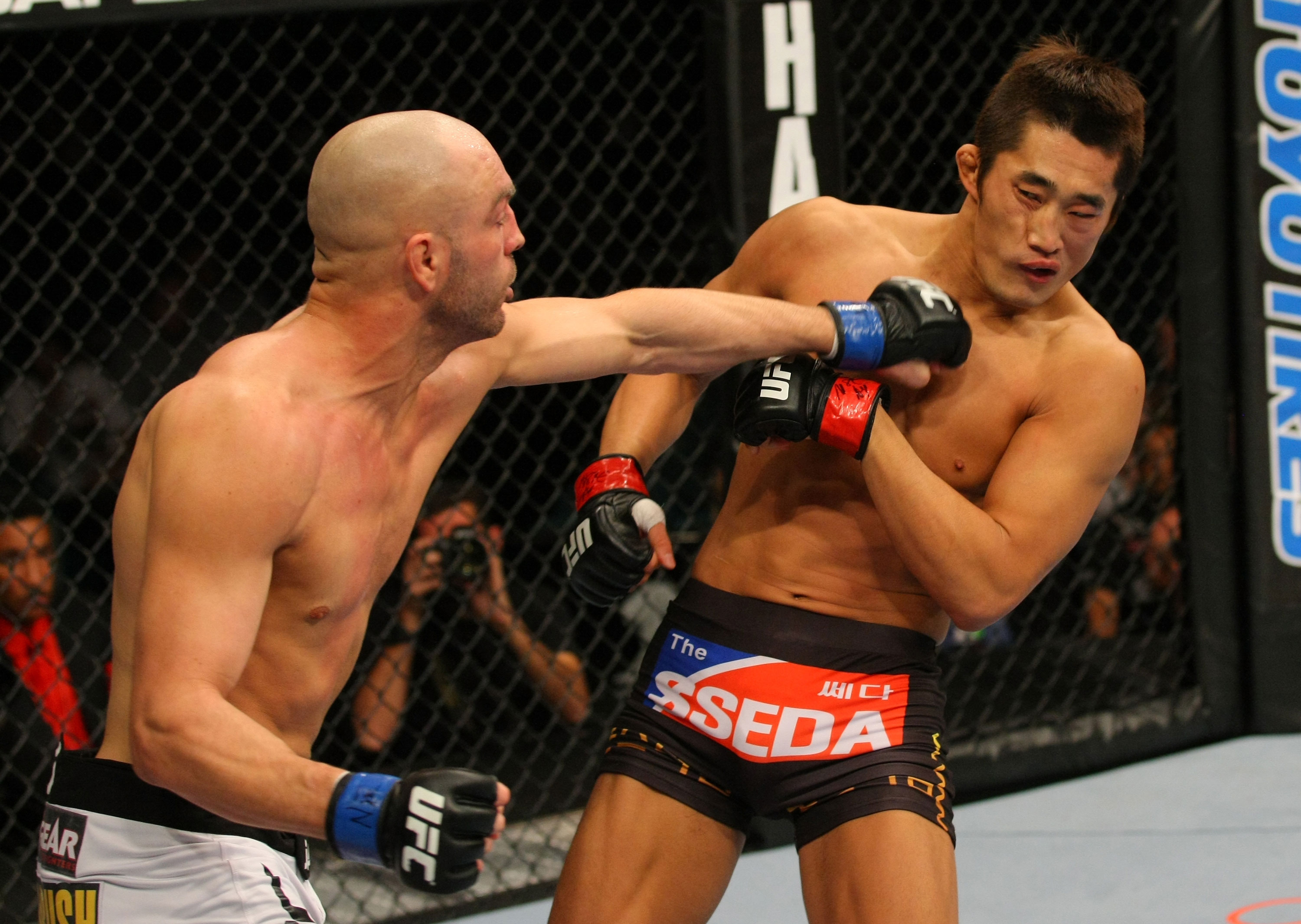 LAS VEGAS, NV - DECEMBER 30:  Sean Pierson (left) punches Dong Hyun Kim (right) during the UFC 141 event at the MGM Grand Garden Arena on December 30, 2011 in Las Vegas, Nevada.  (Photo by Donald Miralle/Zuffa LLC/Zuffa LLC via Getty Images) *** Local Caption *** Sean Pierson; Dong Hyun Kim