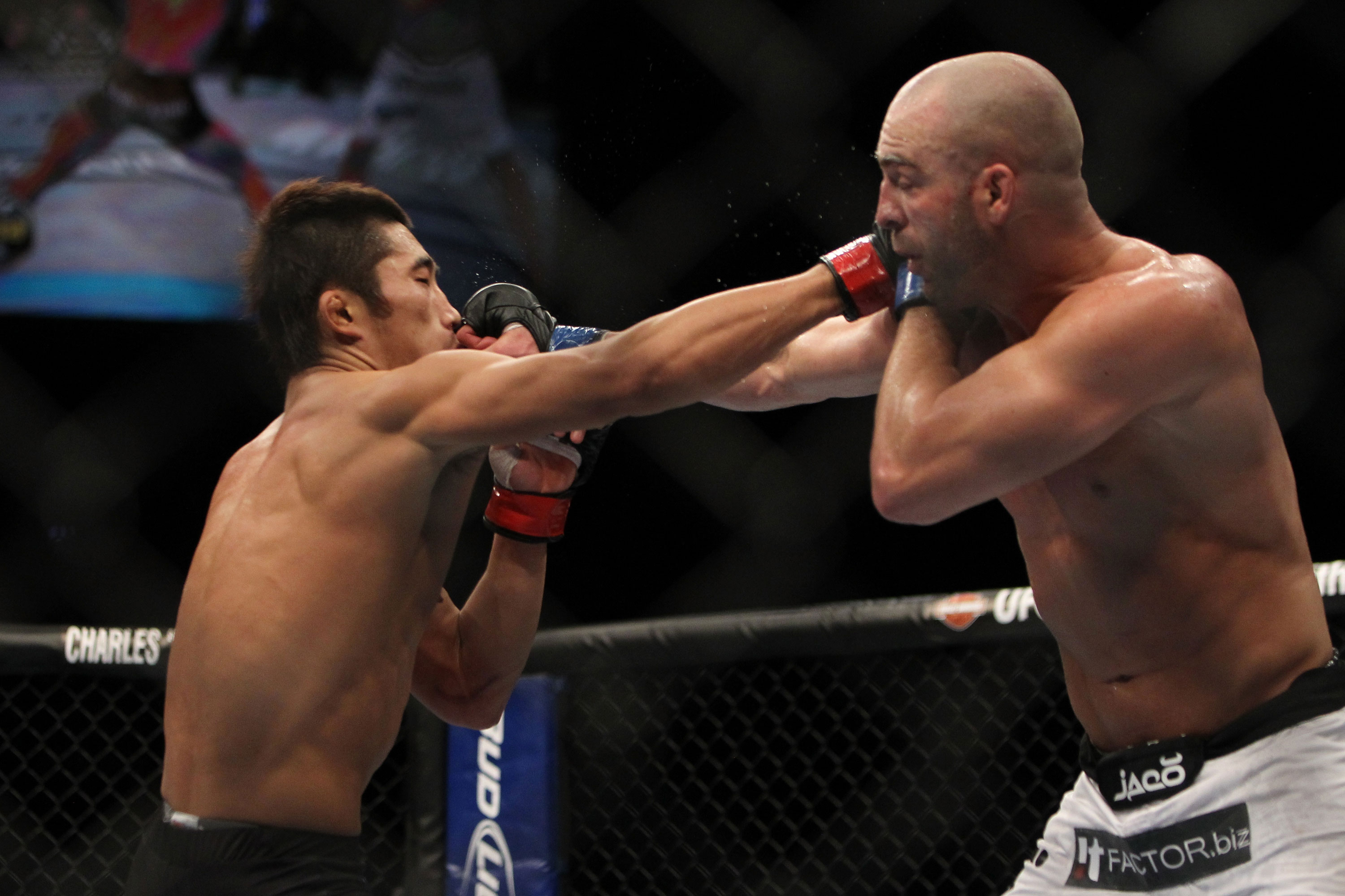LAS VEGAS, NV - DECEMBER 30:  Dong Hyun Kim (left) and Sean Pierson (right) exchange punches during the UFC 141 event at the MGM Grand Garden Arena on December 30, 2011 in Las Vegas, Nevada.  (Photo by Josh Hedges/Zuffa LLC/Zuffa LLC via Getty Images) *** Local Caption *** Dong Hyun Kim; Sean Pierson