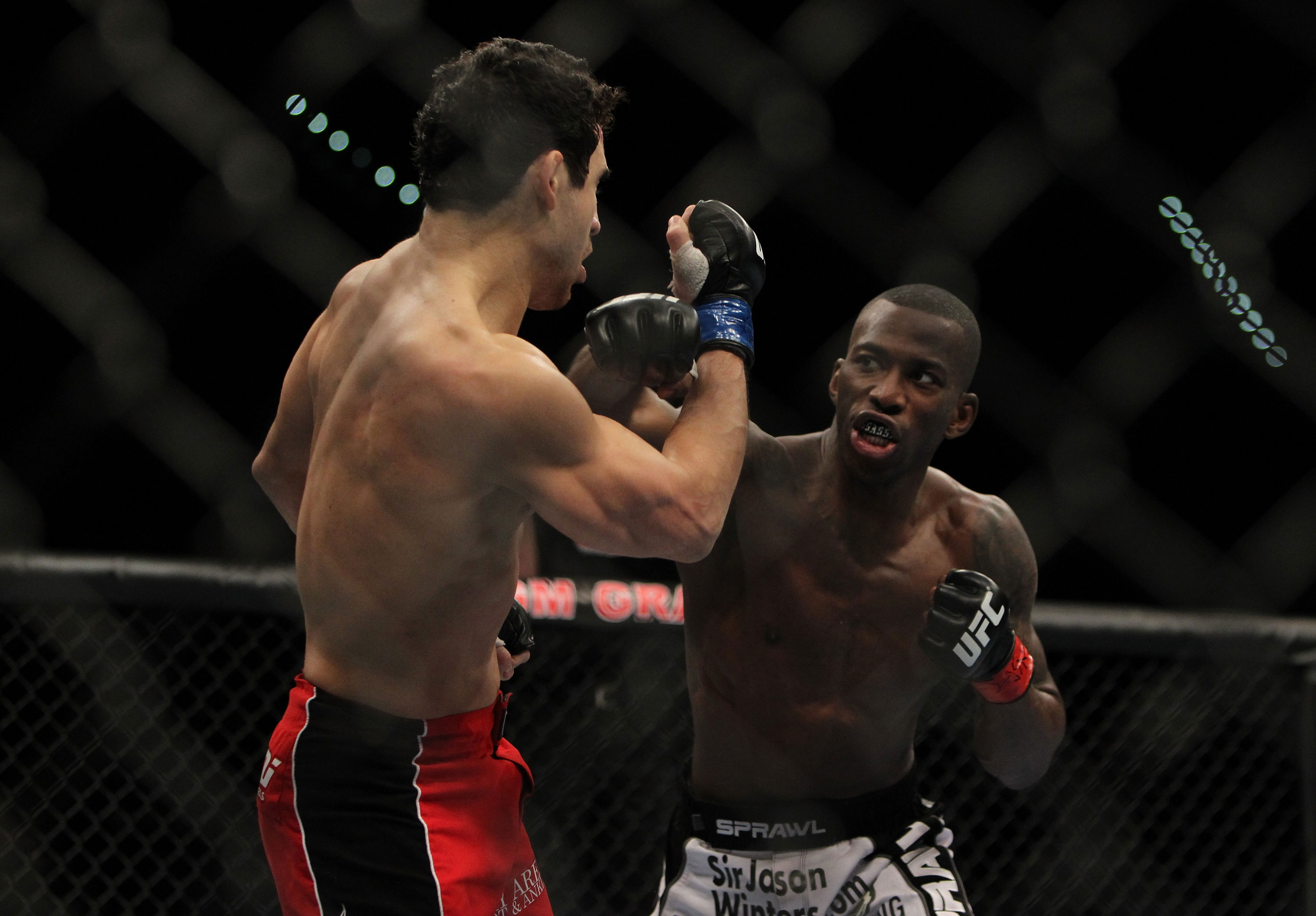 LAS VEGAS, NV - DECEMBER 30:  Anthony Njokuani (right) throws a punch at Danny Castillo (left) during the UFC 141 event at the MGM Grand Garden Arena on December 30, 2011 in Las Vegas, Nevada.  (Photo by Josh Hedges/Zuffa LLC/Zuffa LLC via Getty Images) *** Local Caption *** Anthony Njokuani; Danny Castillo