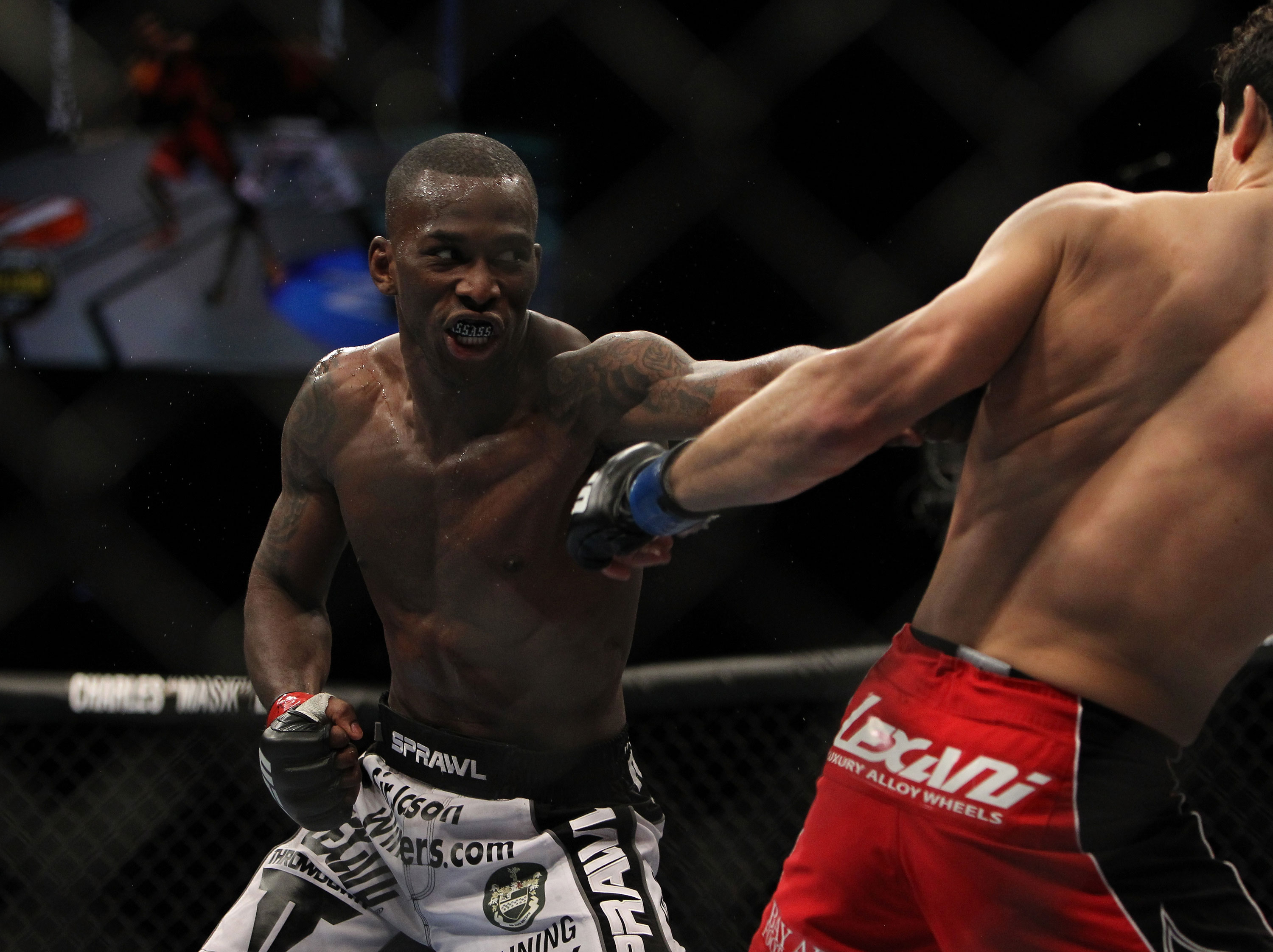 LAS VEGAS, NV - DECEMBER 30:  Anthony Njokuani (left) punches Danny Castillo (right) during the UFC 141 event at the MGM Grand Garden Arena on December 30, 2011 in Las Vegas, Nevada.  (Photo by Josh Hedges/Zuffa LLC/Zuffa LLC via Getty Images) *** Local Caption *** Anthony Njokuani; Danny Castillo