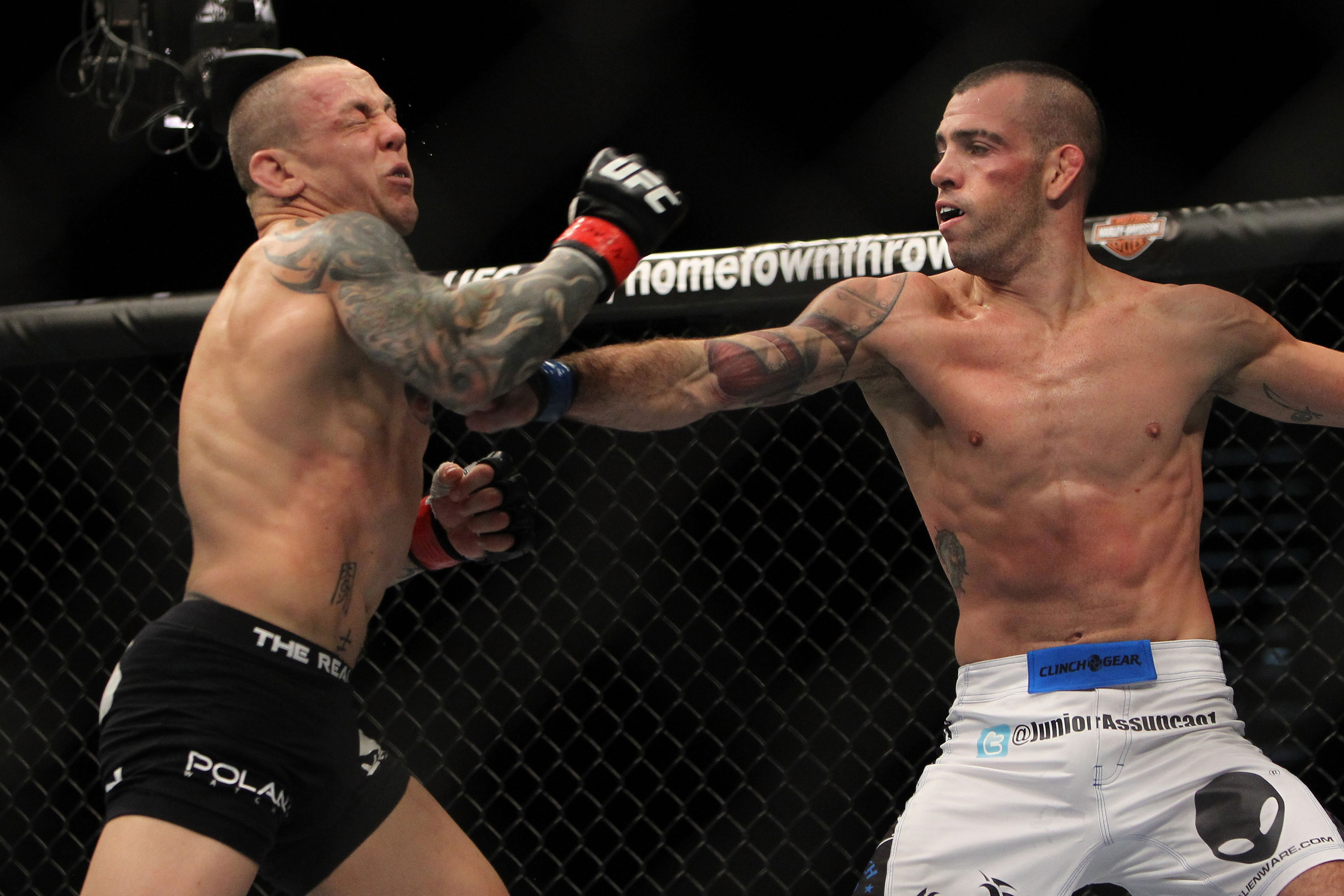 LAS VEGAS, NV - DECEMBER 30:  Junior Assuncao (white shorts) punches Ross Pearson (black shorts) during the UFC 141 event at the MGM Grand Garden Arena on December 30, 2011 in Las Vegas, Nevada.  (Photo by Josh Hedges/Zuffa LLC/Zuffa LLC via Getty Images) *** Local Caption *** Junior Assuncao; Ross Pearson