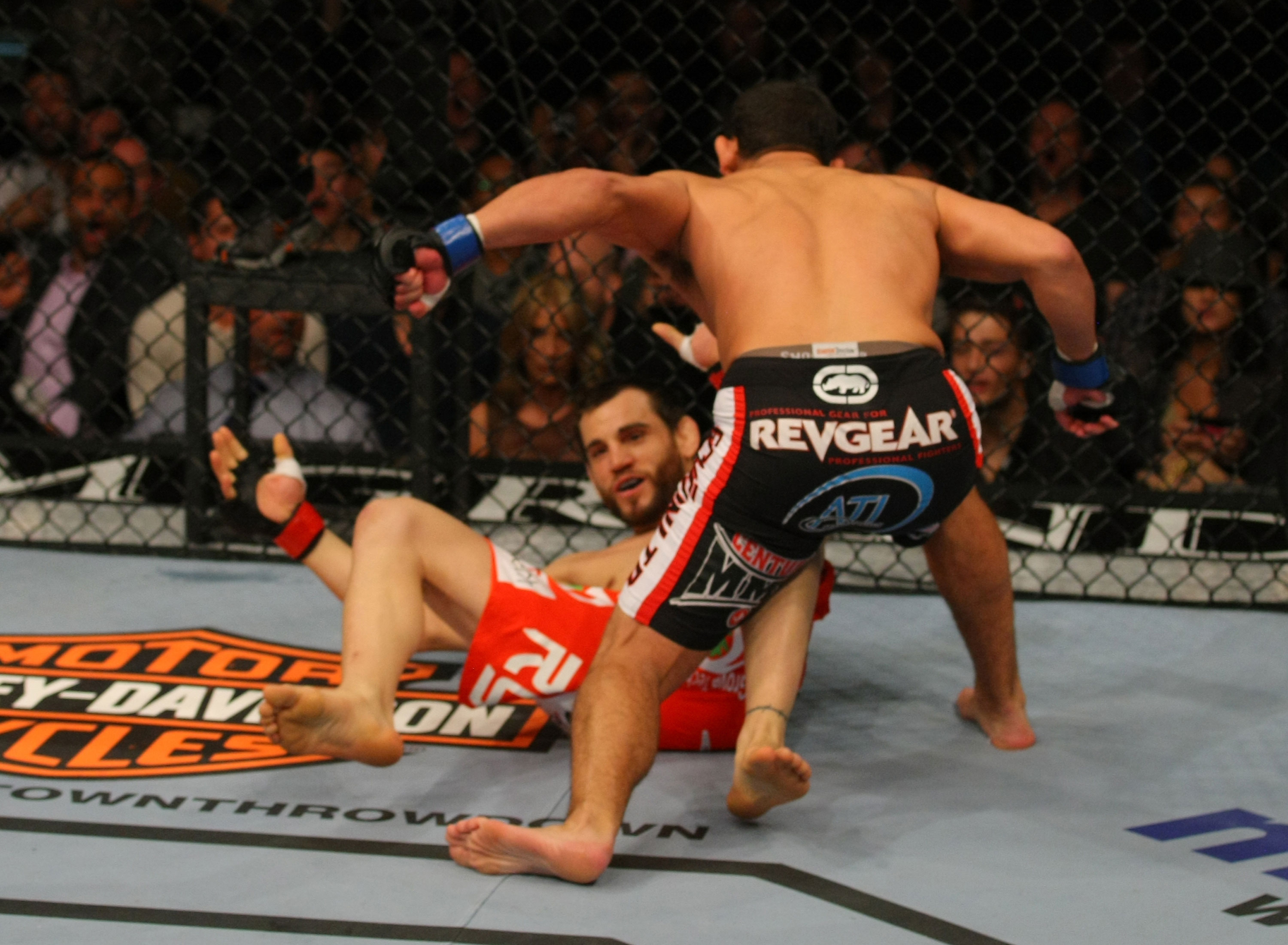 LAS VEGAS, NV - DECEMBER 30:  Johny Hendricks (black shorts) throws a punch at Jon Fitch during the UFC 141 event at the MGM Grand Garden Arena on December 30, 2011 in Las Vegas, Nevada.  (Photo by Donald Miralle/Zuffa LLC/Zuffa LLC via Getty Images) *** Local Caption *** Johny Hendricks; Jon Fitch
