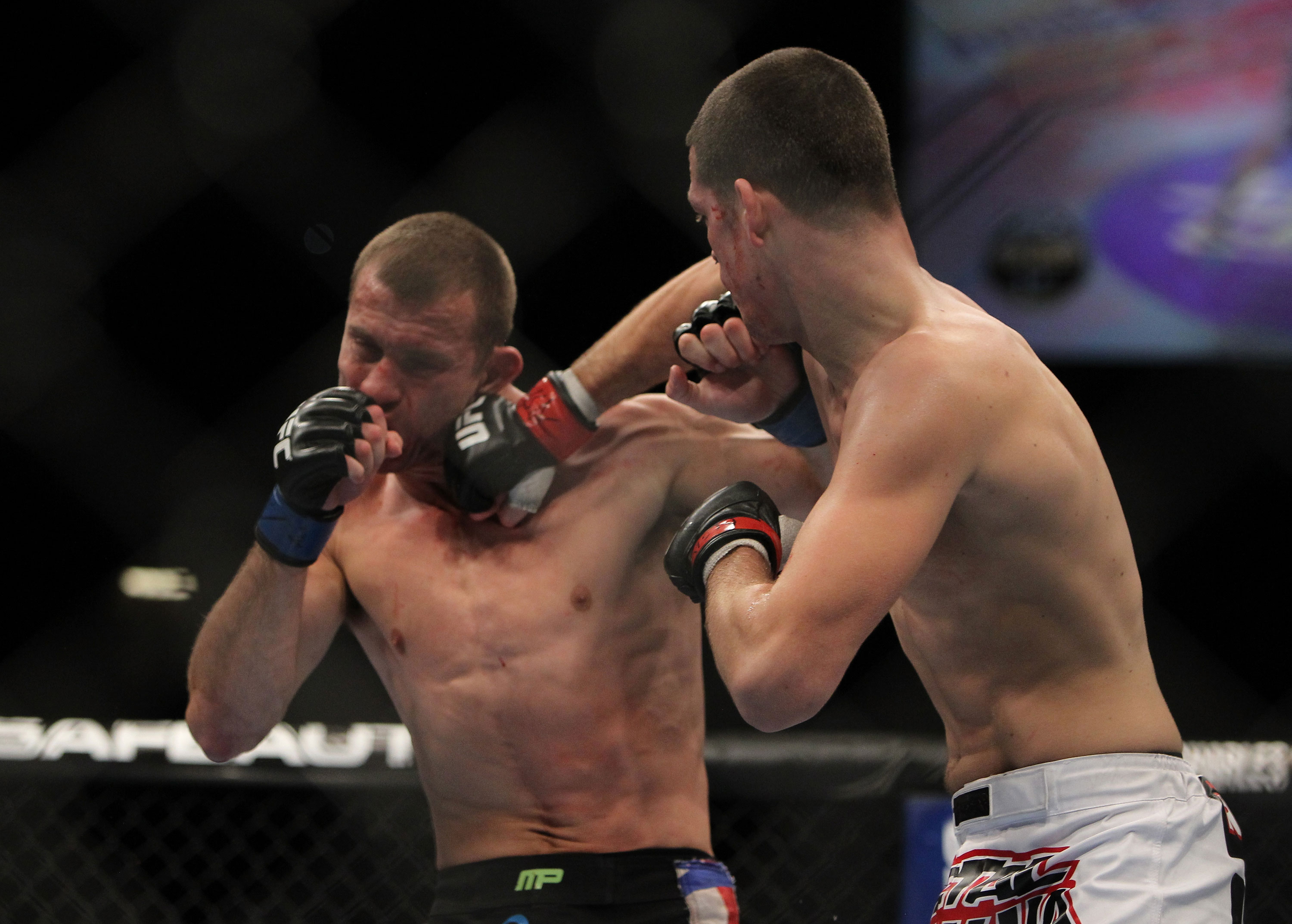 LAS VEGAS, NV - DECEMBER 30:  Nate Diaz (right) punches Donald Cerrone (left) during the UFC 141 event at the MGM Grand Garden Arena on December 30, 2011 in Las Vegas, Nevada.  (Photo by Josh Hedges/Zuffa LLC/Zuffa LLC via Getty Images) *** Local Caption *** Nate Diaz; Donald Cerrone