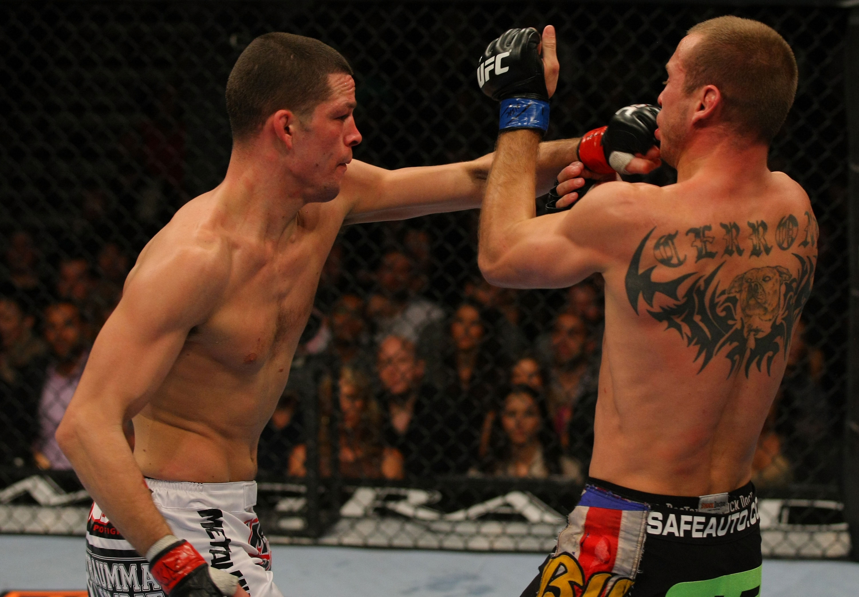 LAS VEGAS, NV - DECEMBER 30:  Nate Diaz (left) punches Donald Cerrone (right) during the UFC 141 event at the MGM Grand Garden Arena on December 30, 2011 in Las Vegas, Nevada.  (Photo by Donald Miralle/Zuffa LLC/Zuffa LLC via Getty Images) *** Local Caption *** Nate Diaz; Donald Cerrone