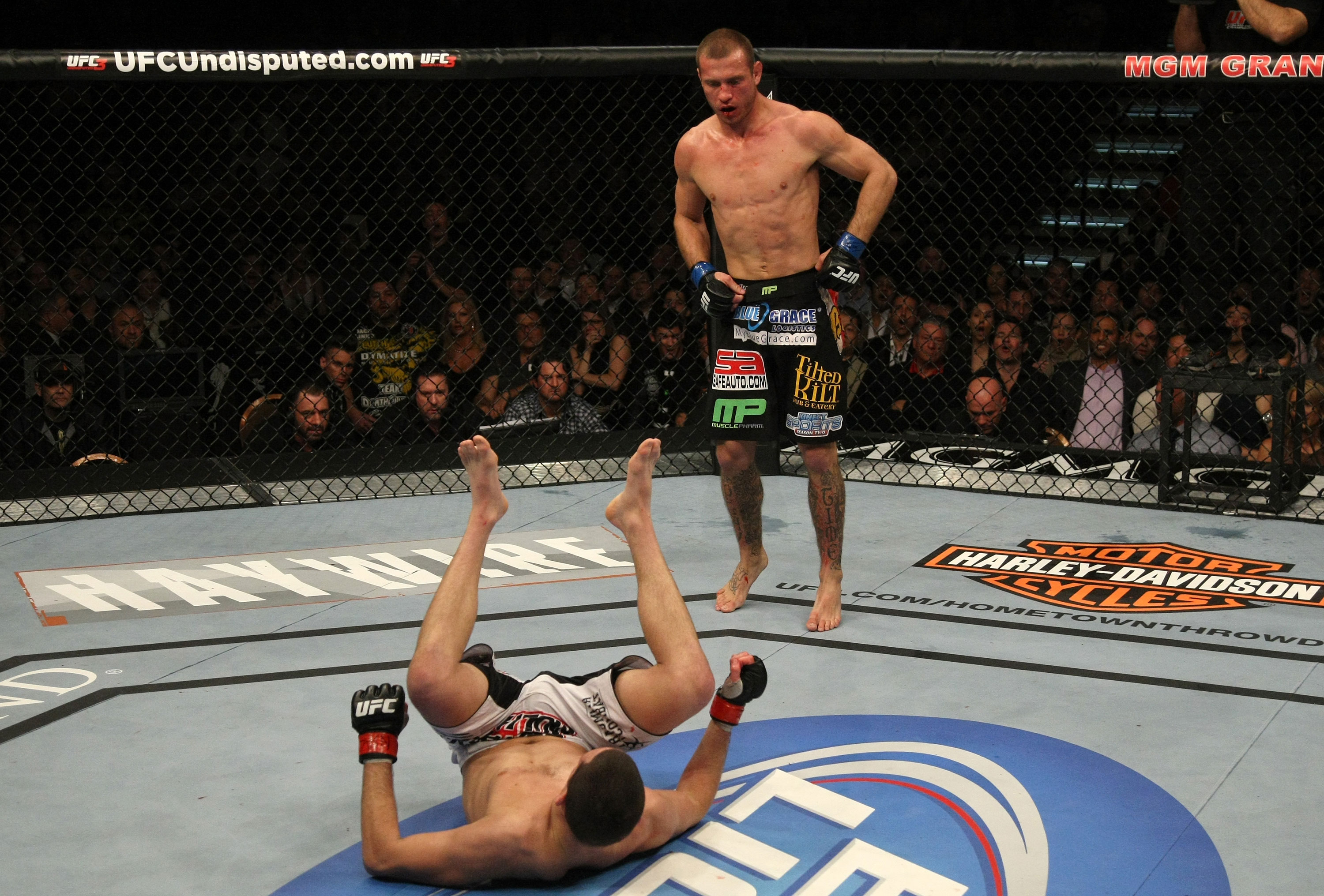 LAS VEGAS, NV - DECEMBER 30:  Donald Cerrone (top) stands over Nate Diaz after a knockdown during the UFC 141 event at the MGM Grand Garden Arena on December 30, 2011 in Las Vegas, Nevada.  (Photo by Donald Miralle/Zuffa LLC/Zuffa LLC via Getty Images) *** Local Caption *** Donald Cerrone; Nate Diaz