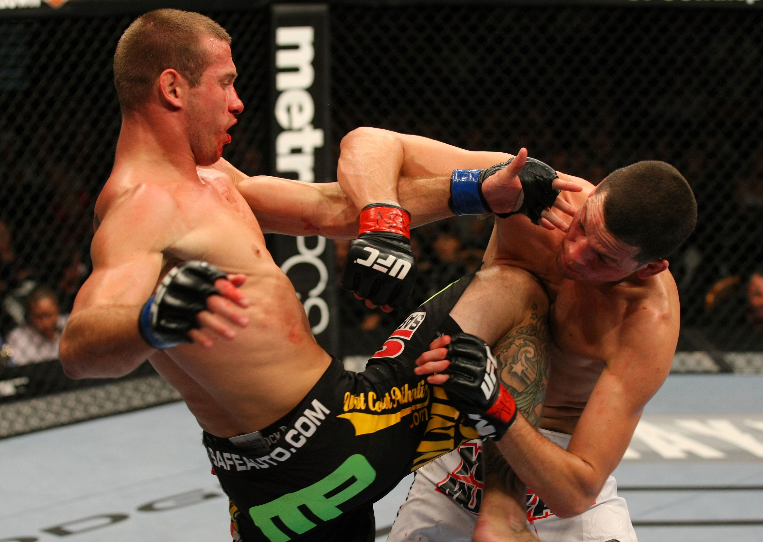 LAS VEGAS, NV - DECEMBER 30:  Donald Cerrone (left) hits Nate Diaz with a knee strike during the UFC 141 event at the MGM Grand Garden Arena on December 30, 2011 in Las Vegas, Nevada.  (Photo by Donald Miralle/Zuffa LLC/Zuffa LLC via Getty Images) *** Local Caption *** Donald Cerrone; Nate Diaz
