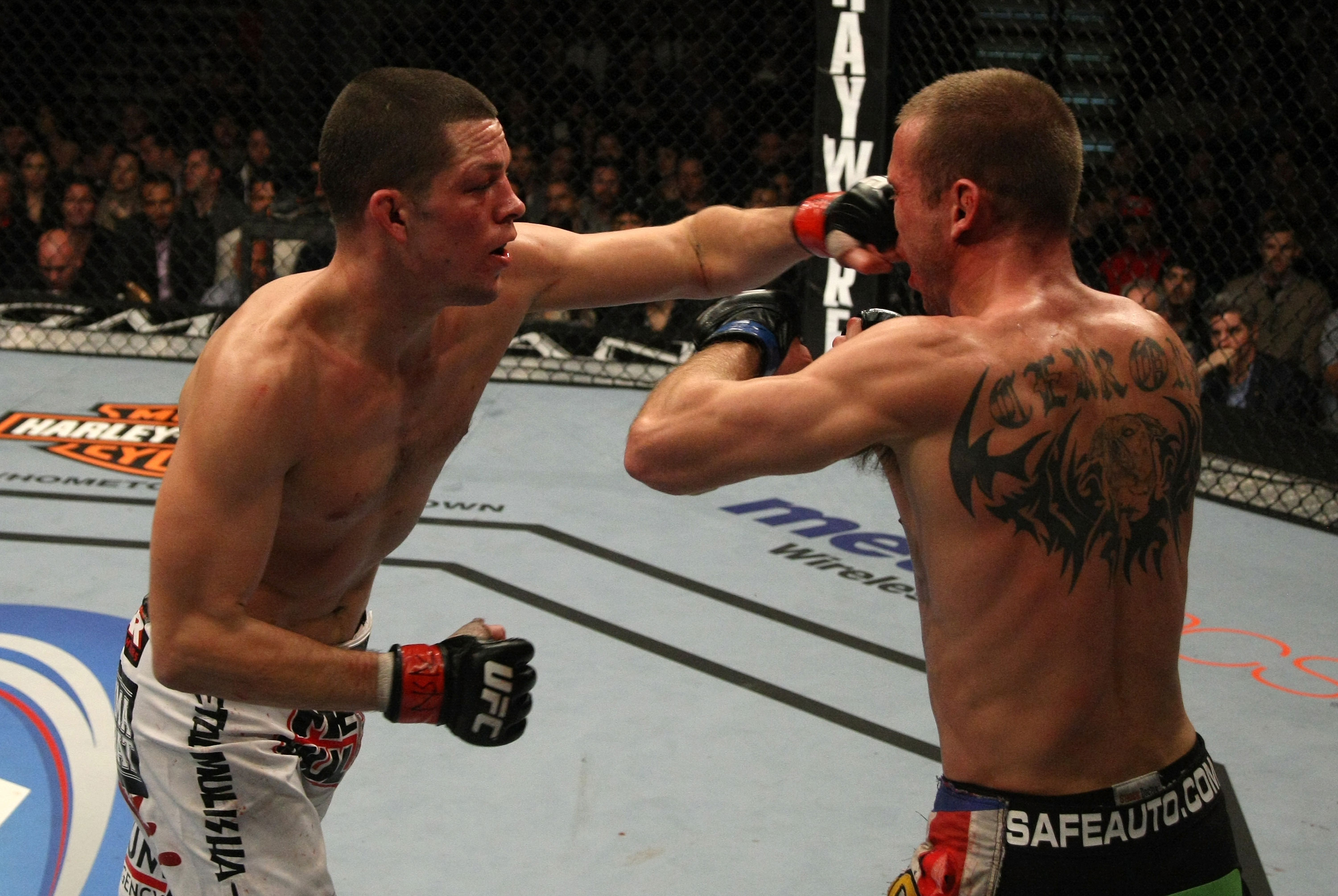 LAS VEGAS, NV - DECEMBER 30:  Nate Diaz (left) punches Donald Cerrone during the UFC 141 event at the MGM Grand Garden Arena on December 30, 2011 in Las Vegas, Nevada.  (Photo by Donald Miralle/Zuffa LLC/Zuffa LLC via Getty Images) *** Local Caption *** Nate Diaz; Donald Cerrone