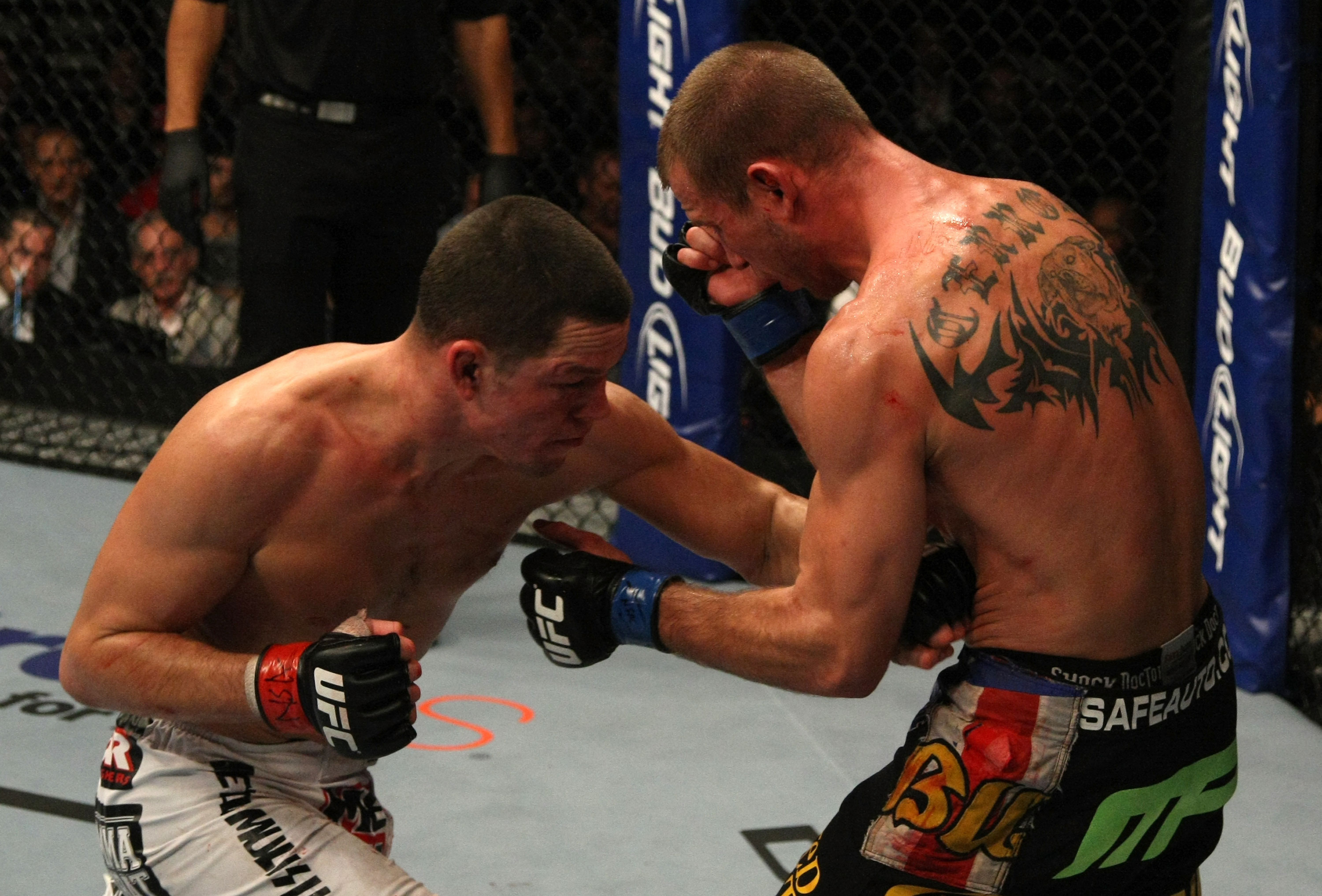 LAS VEGAS, NV - DECEMBER 30:  Nate Diaz (left) hits Donald Cerrone with a punch to the body during the UFC 141 event at the MGM Grand Garden Arena on December 30, 2011 in Las Vegas, Nevada.  (Photo by Donald Miralle/Zuffa LLC/Zuffa LLC via Getty Images) *** Local Caption *** Nate Diaz; Donald Cerrone