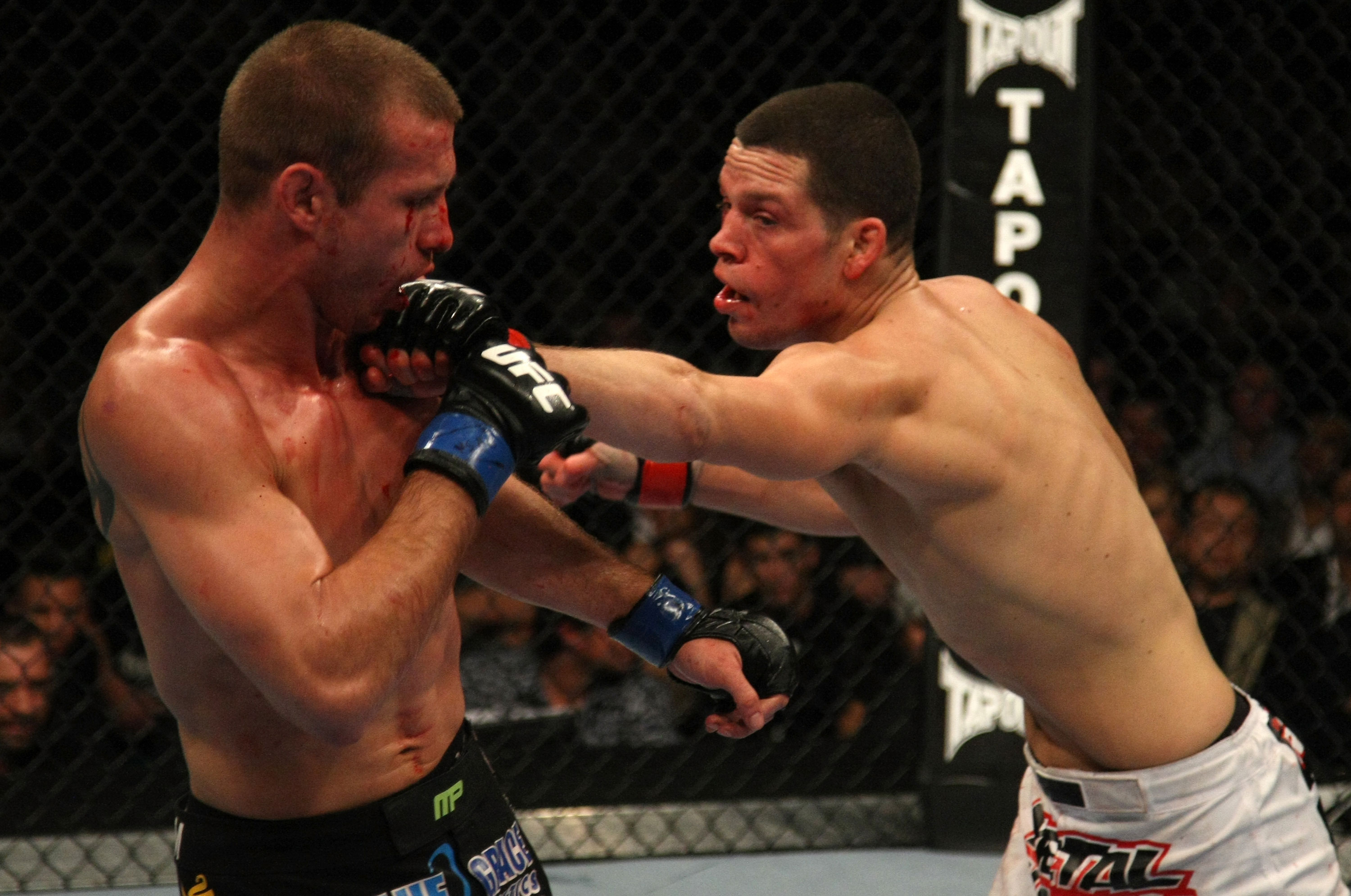 Donald Cerrone (left) and Nate Diaz (right) exchange blows during the UFC 141 event at the MGM Grand Garden Arena on December 30, 2011 in Las Vegas, Nevada. (Photo by Donald Miralle/Zuffa LLC)