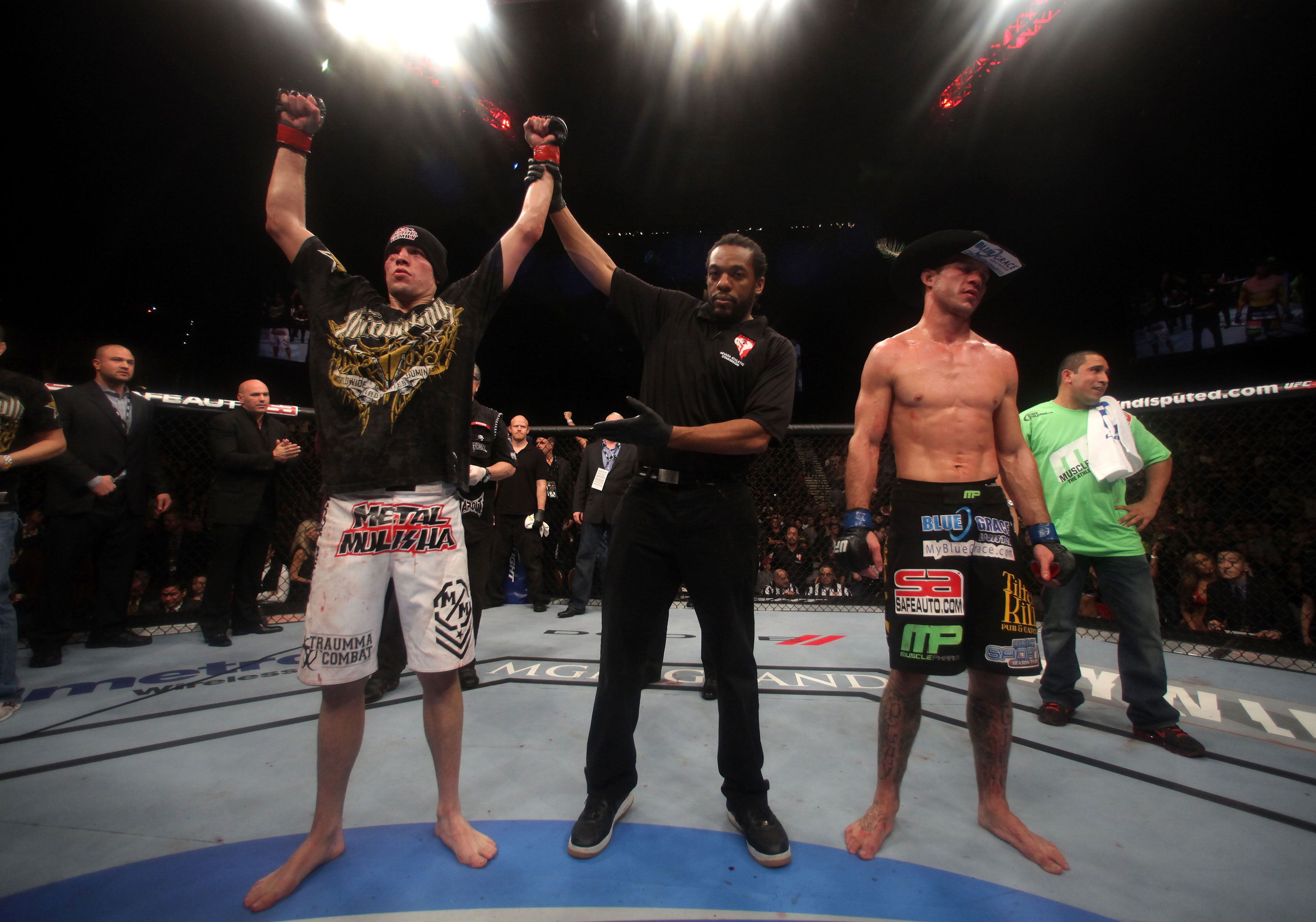 LAS VEGAS, NV - DECEMBER 30:  Nate Diaz (left) is declared the winner in his fight with Donald Cerrone (black shorts) during the UFC 141 event at the MGM Grand Garden Arena on December 30, 2011 in Las Vegas, Nevada.  (Photo by Donald Miralle/Zuffa LLC/Zuffa LLC via Getty Images) *** Local Caption *** Nate Diaz; Donald Cerrone
