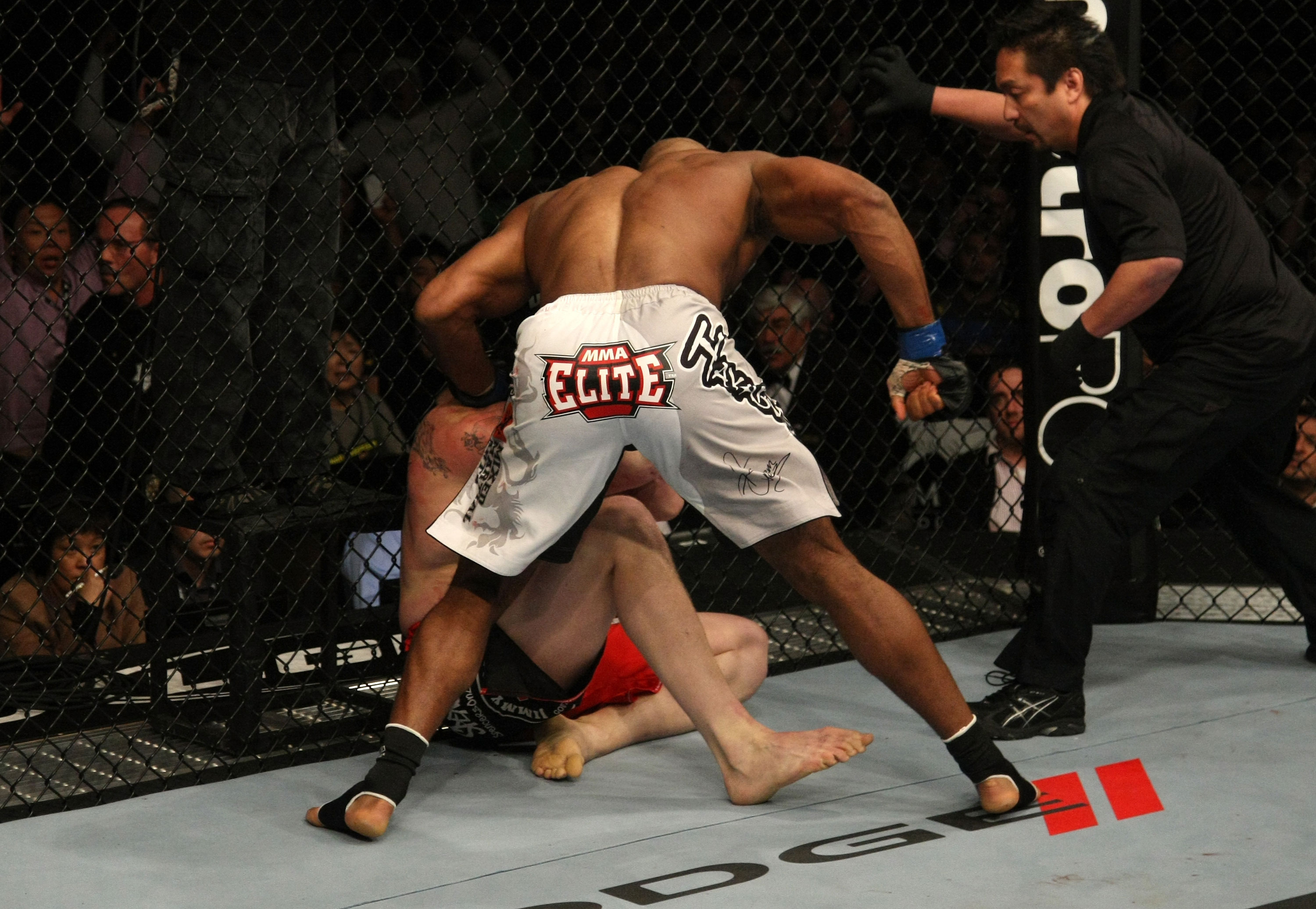 LAS VEGAS, NV - DECEMBER 30:  Alistair Overeem (white shorts) punches Brock Lesnar during the UFC 141 event at the MGM Grand Garden Arena on December 30, 2011 in Las Vegas, Nevada.  (Photo by Donald Miralle/Zuffa LLC/Zuffa LLC via Getty Images) *** Local Caption *** Alistair Overeem
