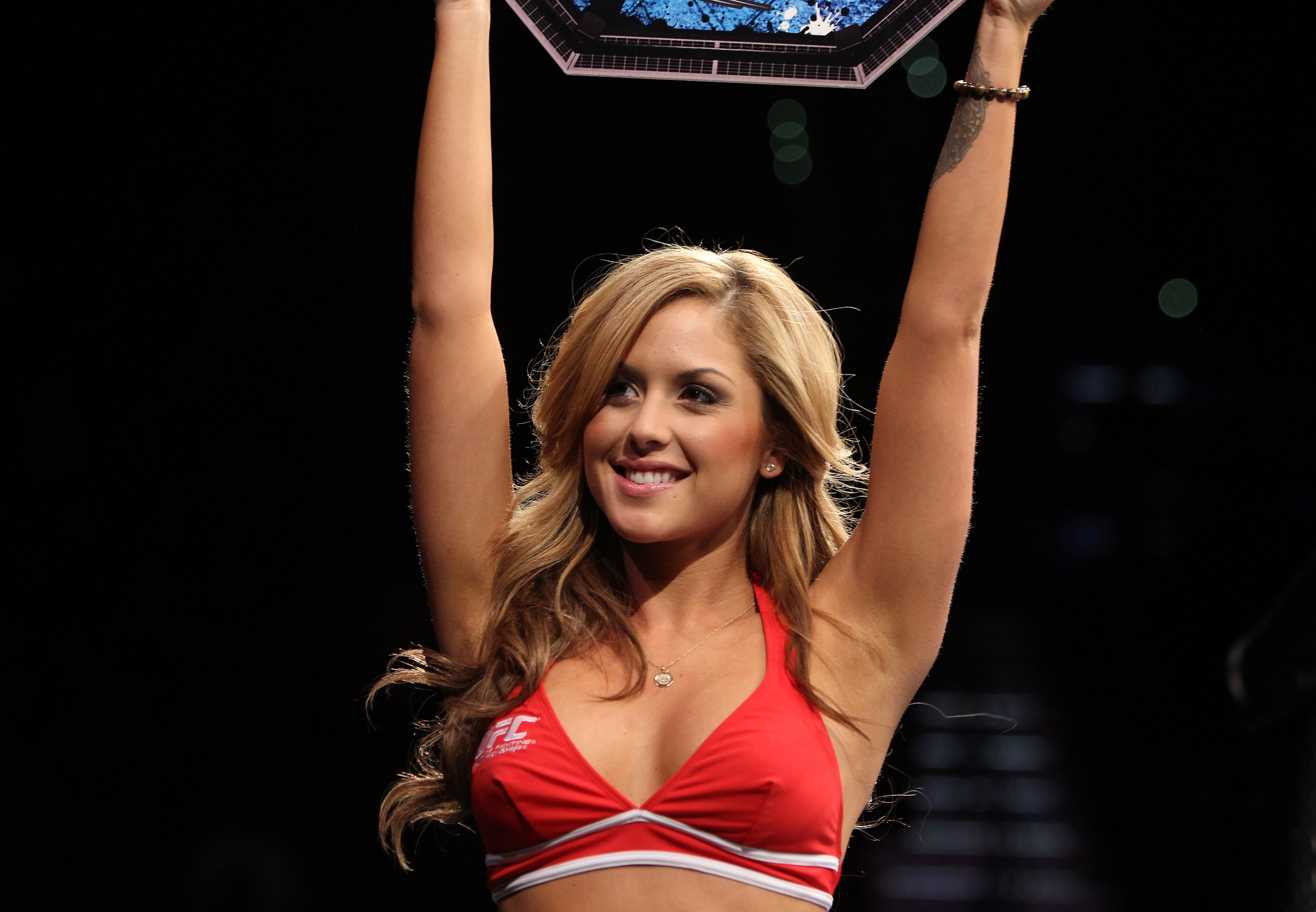 LAS VEGAS, NV - DECEMBER 30:  Octagon Girl Brittney Palmer introduces a round during the UFC 141 event at the MGM Grand Garden Arena on December 30, 2011 in Las Vegas, Nevada.  (Photo by Josh Hedges/Zuffa LLC/Zuffa LLC via Getty Images) *** Local Caption *** Brittney Palmer