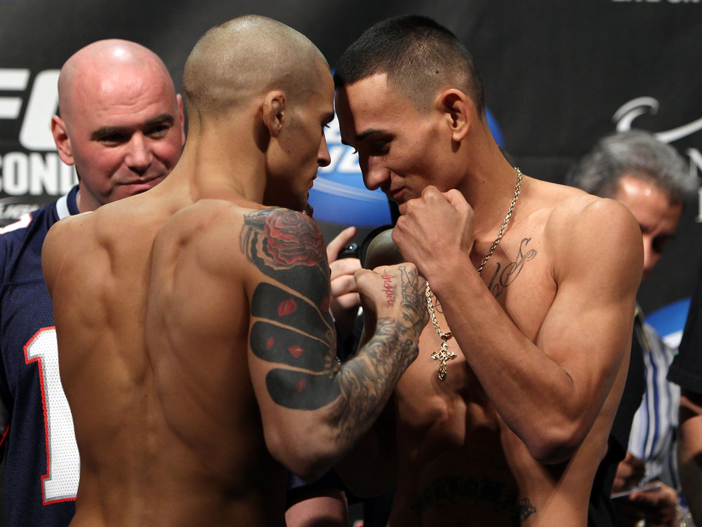 LAS VEGAS, NV - FEBRUARY 03:  (L-R) Featherweight opponents Dustin Poirier and Max Holloway face off after weighing in during the UFC 143 official weigh in at Mandalay Bay Events Center on February 3, 2012 in Las Vegas, Nevada.|2:55:8  (Photo by Josh Hedges/Zuffa LLC/Zuffa LLC via Getty Images) *** Local Caption *** Dustin Poirier; Max Holloway
