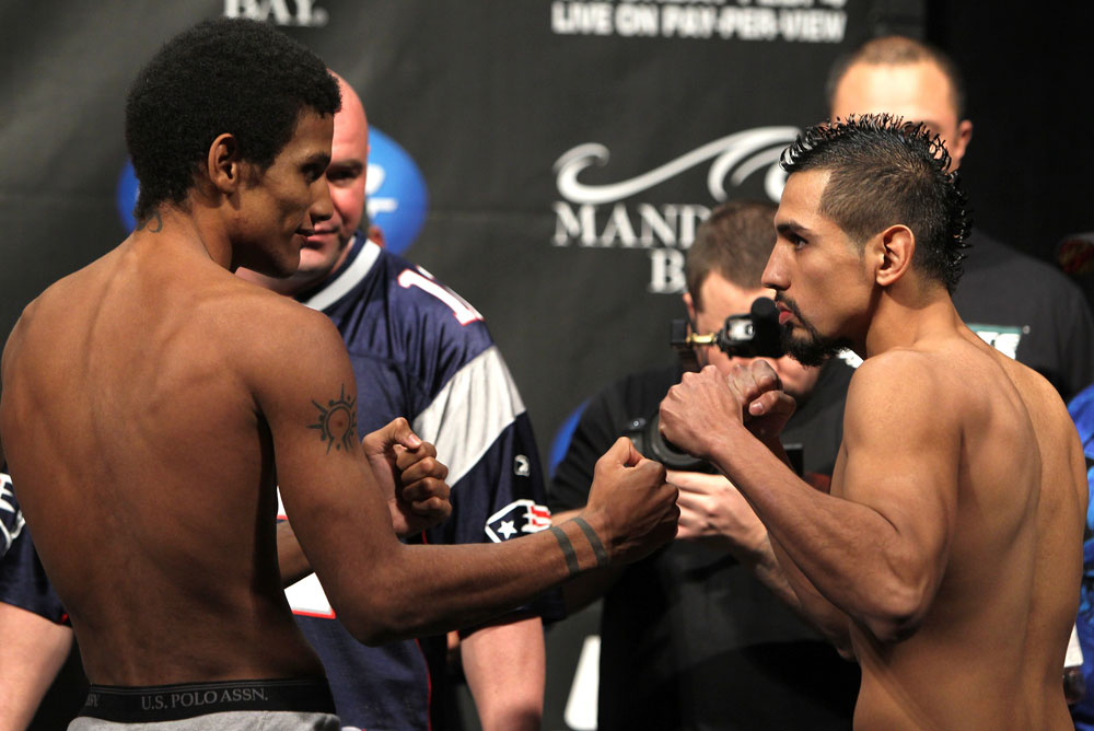 LAS VEGAS, NV - FEBRUARY 03:  (L-R) Bantamweight opponents Alex Caceres and Edwin Figueroa face off after weighing in during the UFC 143 official weigh in at Mandalay Bay Events Center on February 3, 2012 in Las Vegas, Nevada.  (Photo by Josh Hedges/Zuffa LLC/Zuffa LLC via Getty Images) *** Local Caption *** Alex Caceres; Edwin Figueroa