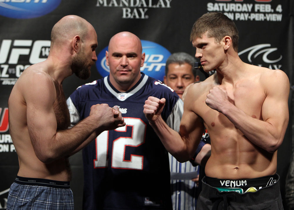 LAS VEGAS, NV - FEBRUARY 03:  (L-R) Opponents Dan Stittgen and Stephen Thompson face off after weighing in during the UFC 143 official weigh in at Mandalay Bay Events Center on February 3, 2012 in Las Vegas, Nevada.|2:55:8  (Photo by Josh Hedges/Zuffa LLC/Zuffa LLC via Getty Images) *** Local Caption *** Dan Stittgen; Stephen Thompson; Dana White