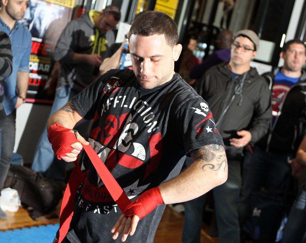 TOKYO, JAPAN - FEBRUARY 22:  UFC Lightweight Champion Frankie Edgar works out for the media during the UFC 144 open workouts at Gold's Gym on February 22, 2012 in Tokyo, Japan.  (Photo by Josh Hedges/Zuffa LLC/Zuffa LLC via Getty Images) *** Local Caption *** Frankie Edgar