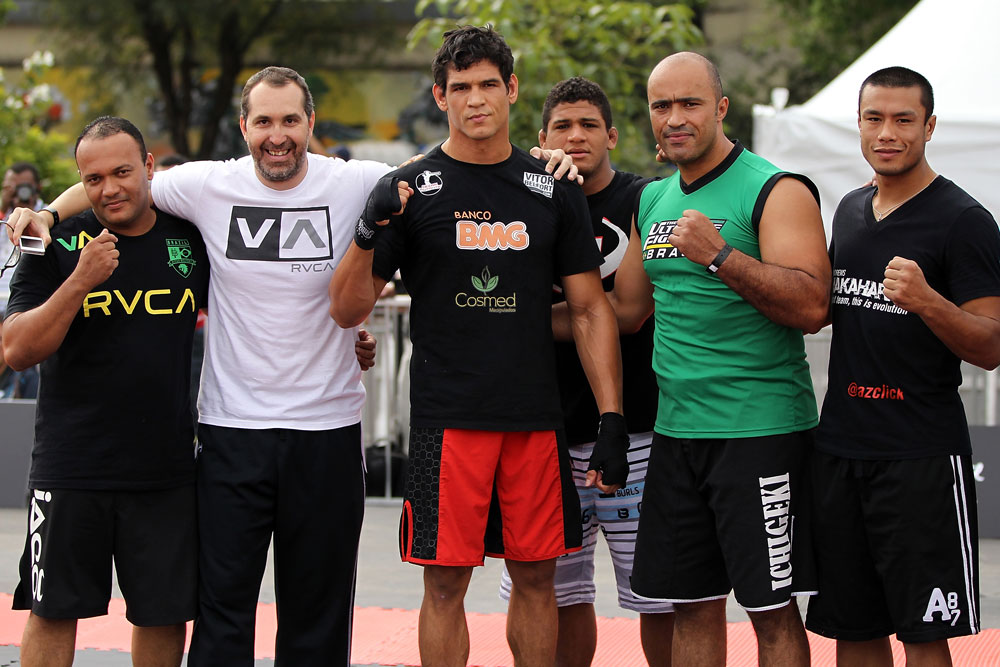 BELO HORIZONTE, BRAZIL - JUNE 20:   Cezar Ferreira (center) poses for a photo with his team during the UFC 147 open workouts at Praca da Estacao on June 20, 2012 in Belo Horizonte, Brazil.  (Photo by Josh Hedges/Zuffa LLC/Zuffa LLC via Getty Images)