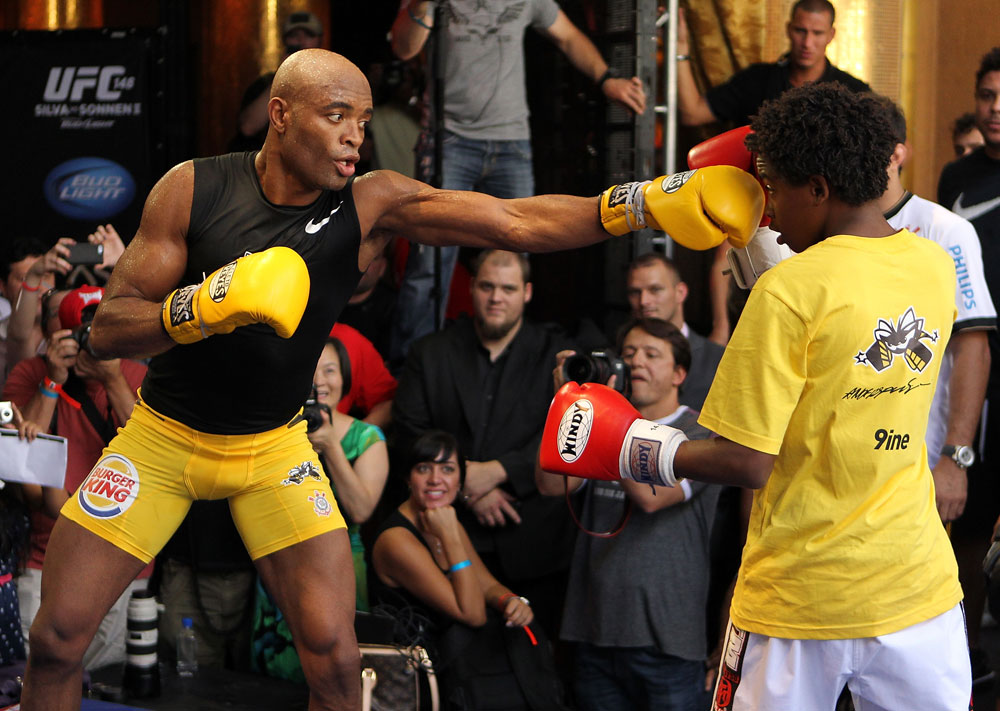 LAS VEGAS, NV - JULY 5:   Anderson Silva works out for the fans and media during the UFC 148 Open Workouts inside XS nightclub at the Encore on July 5, 2012 in Las Vegas, Nevada.  (Photo by Josh Hedges/Zuffa LLC/Zuffa LLC via Getty Images)