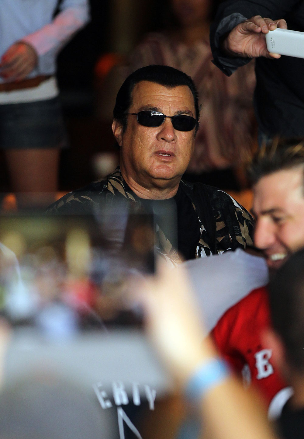 LAS VEGAS, NV - JULY 5:   Actor Steven Seagal looks on as Anderson Silva works out during the UFC 148 Open Workouts inside XS nightclub at the Encore on July 5, 2012 in Las Vegas, Nevada.  (Photo by Josh Hedges/Zuffa LLC/Zuffa LLC via Getty Images)