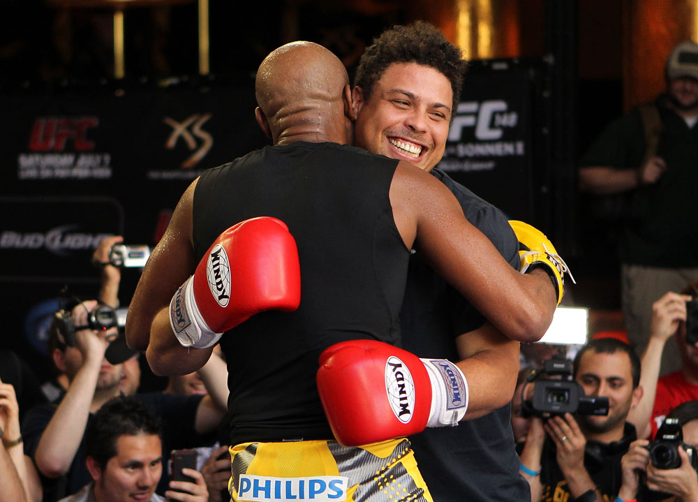 LAS VEGAS, NV - JULY 5:   (L-R) UFC Middleweight Champion Anderson Silva spars with Brazilian soccer legend Ronaldo during the UFC 148 Open Workouts inside XS nightclub at the Encore on July 5, 2012 in Las Vegas, Nevada.  (Photo by Josh Hedges/Zuffa LLC/Zuffa LLC via Getty Images)