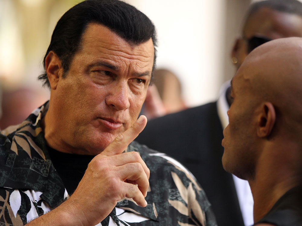 LAS VEGAS, NV - JULY 5:   (L-R) Actor Steven Seagal gives advice to Anderson Silva during the UFC 148 Open Workouts inside XS nightclub at the Encore on July 5, 2012 in Las Vegas, Nevada.  (Photo by Josh Hedges/Zuffa LLC/Zuffa LLC via Getty Images)